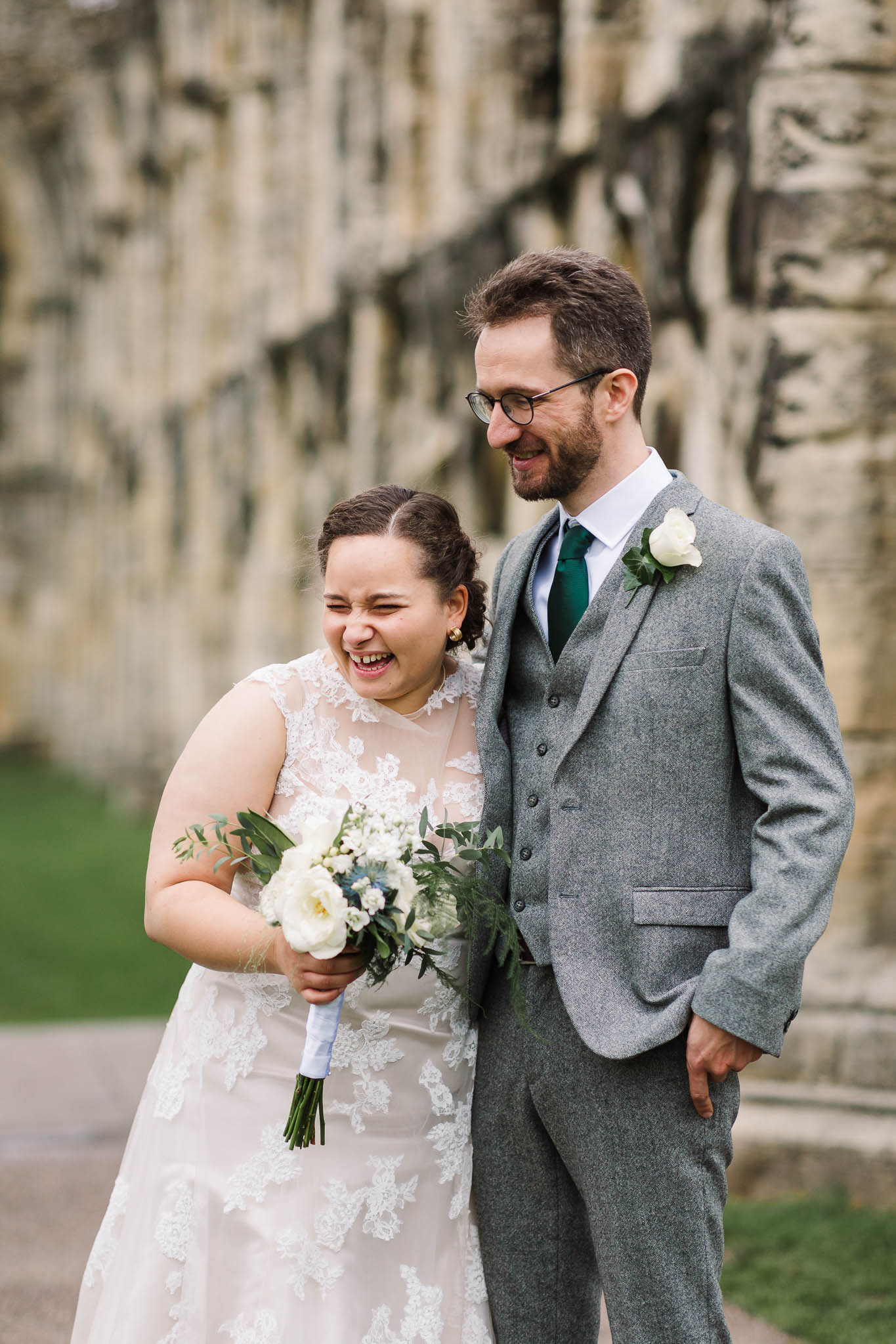bride and groom laughing at autumn wedding