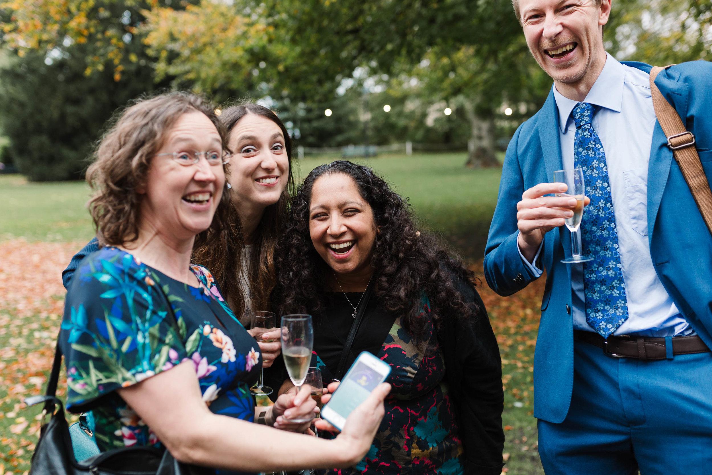 wedding guests having fun in york museum gardens