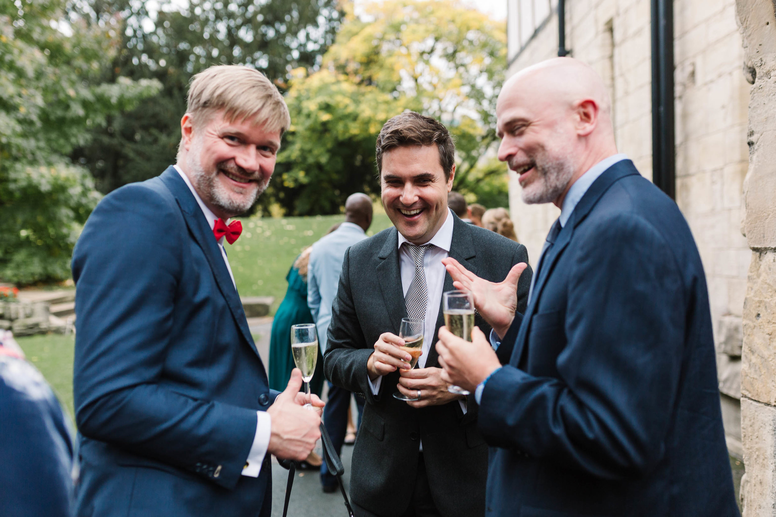 wedding guests laughing - Autumn Wedding at The Hospitium, York