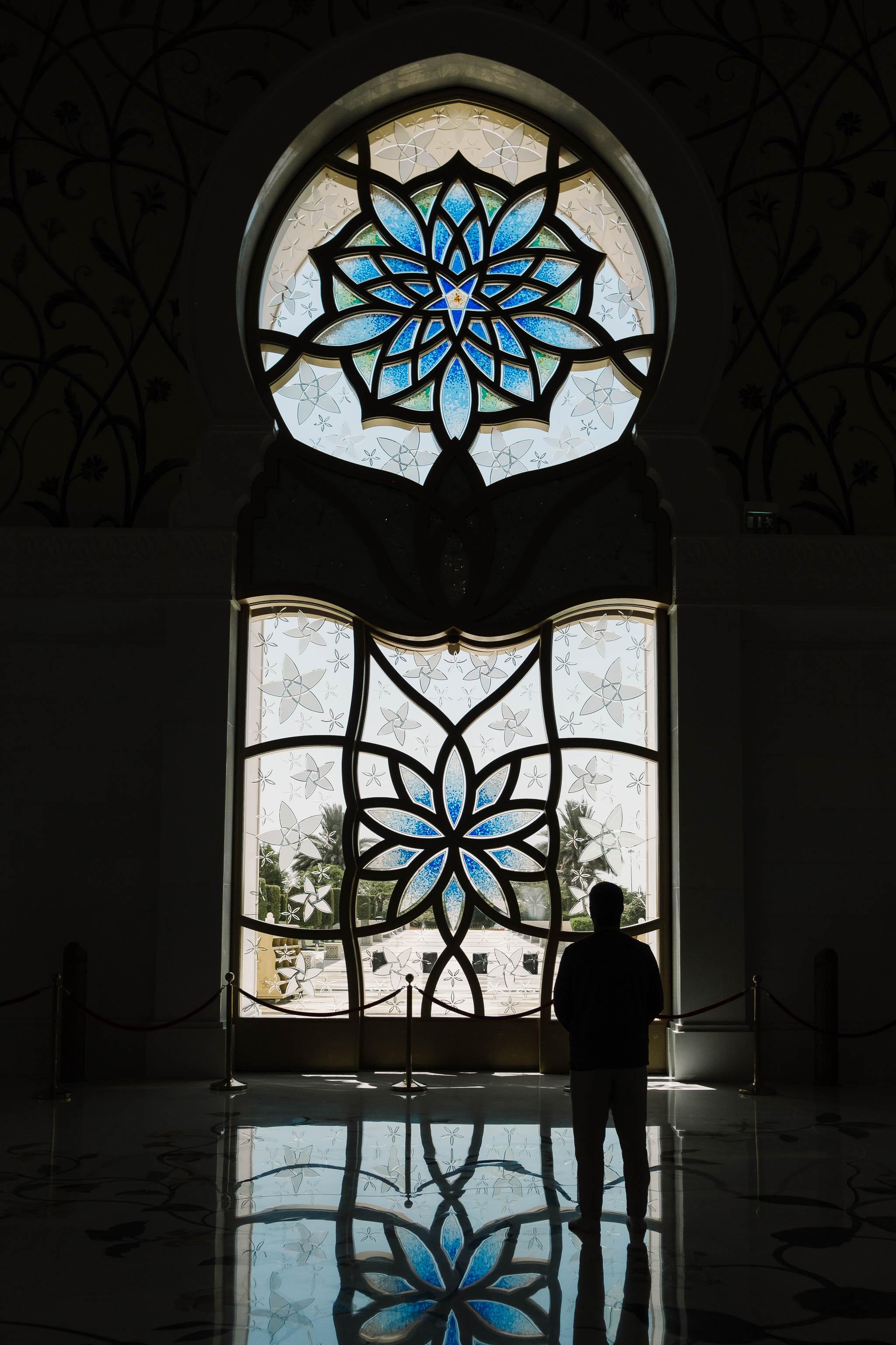figure standing by window in mosque