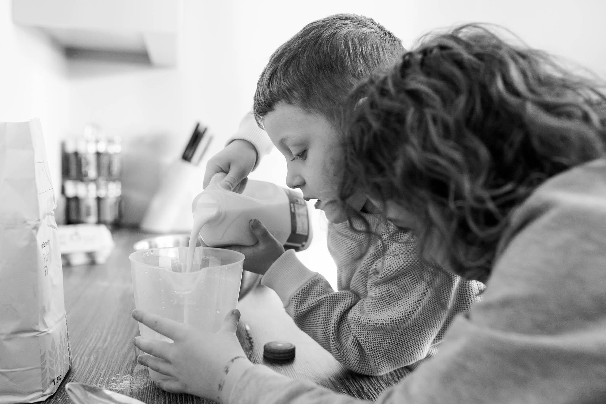 adding the milk to pancakes