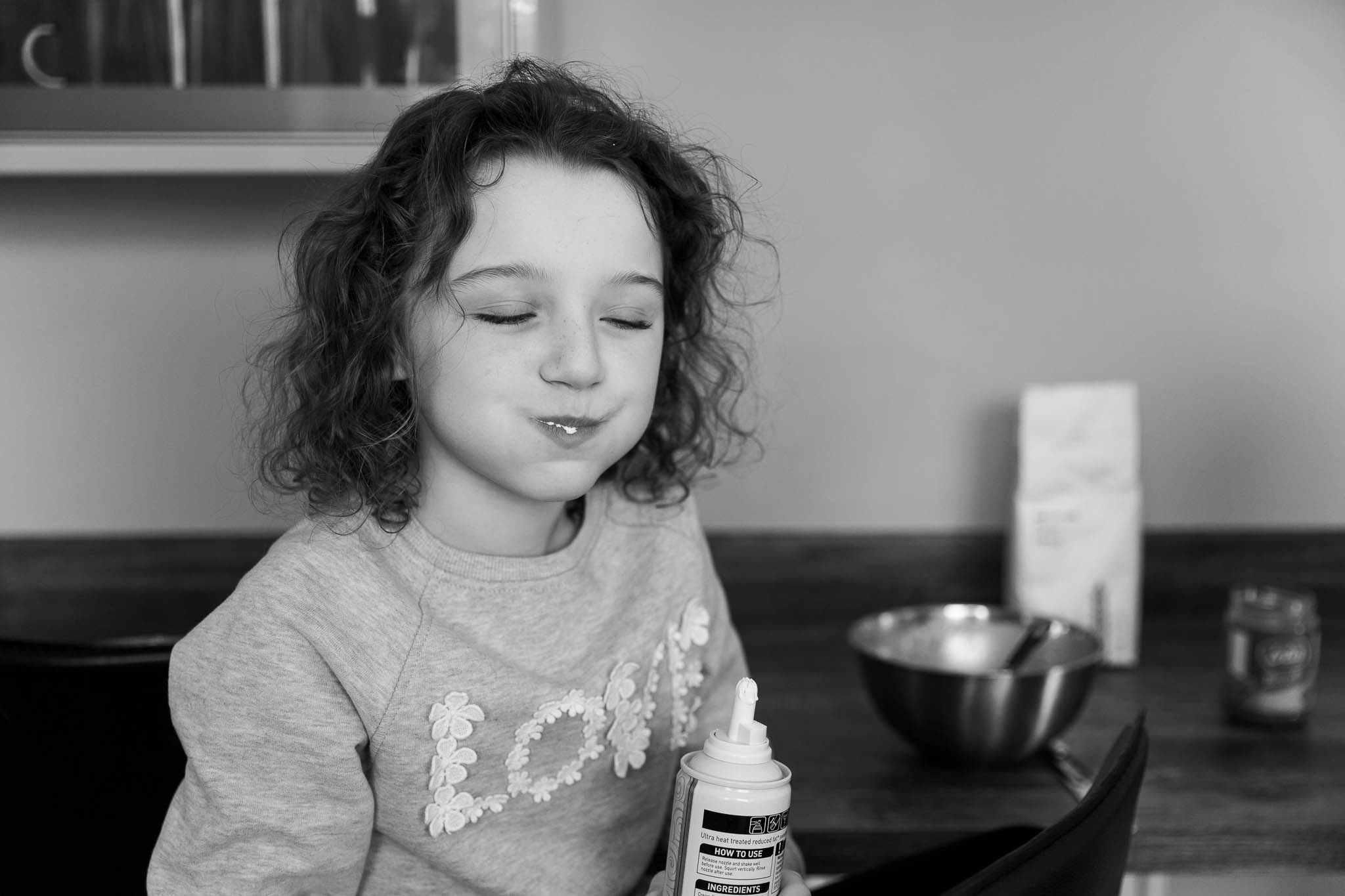little girl with mouth full of food