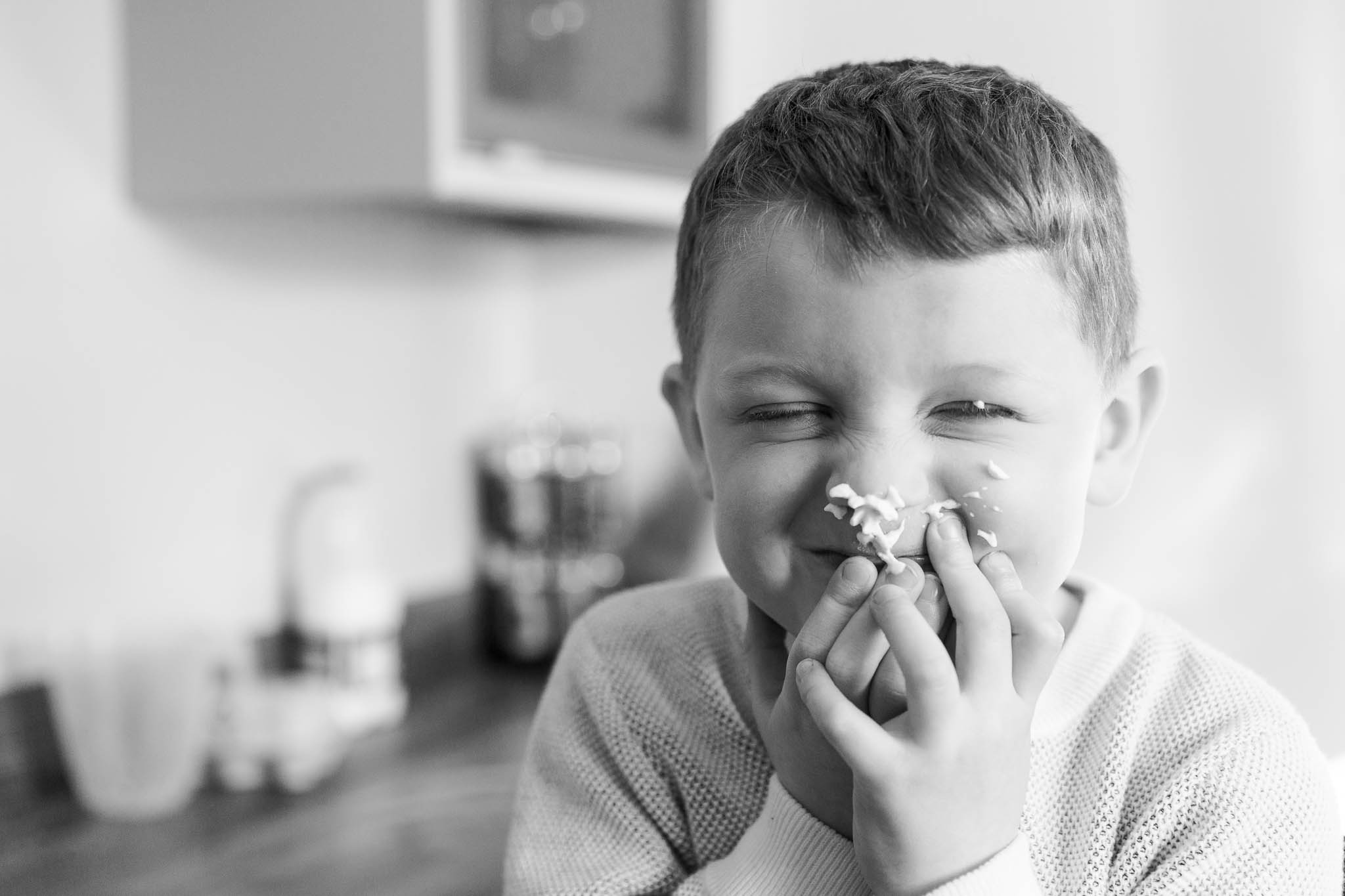 little boy making funny face with cream on nose