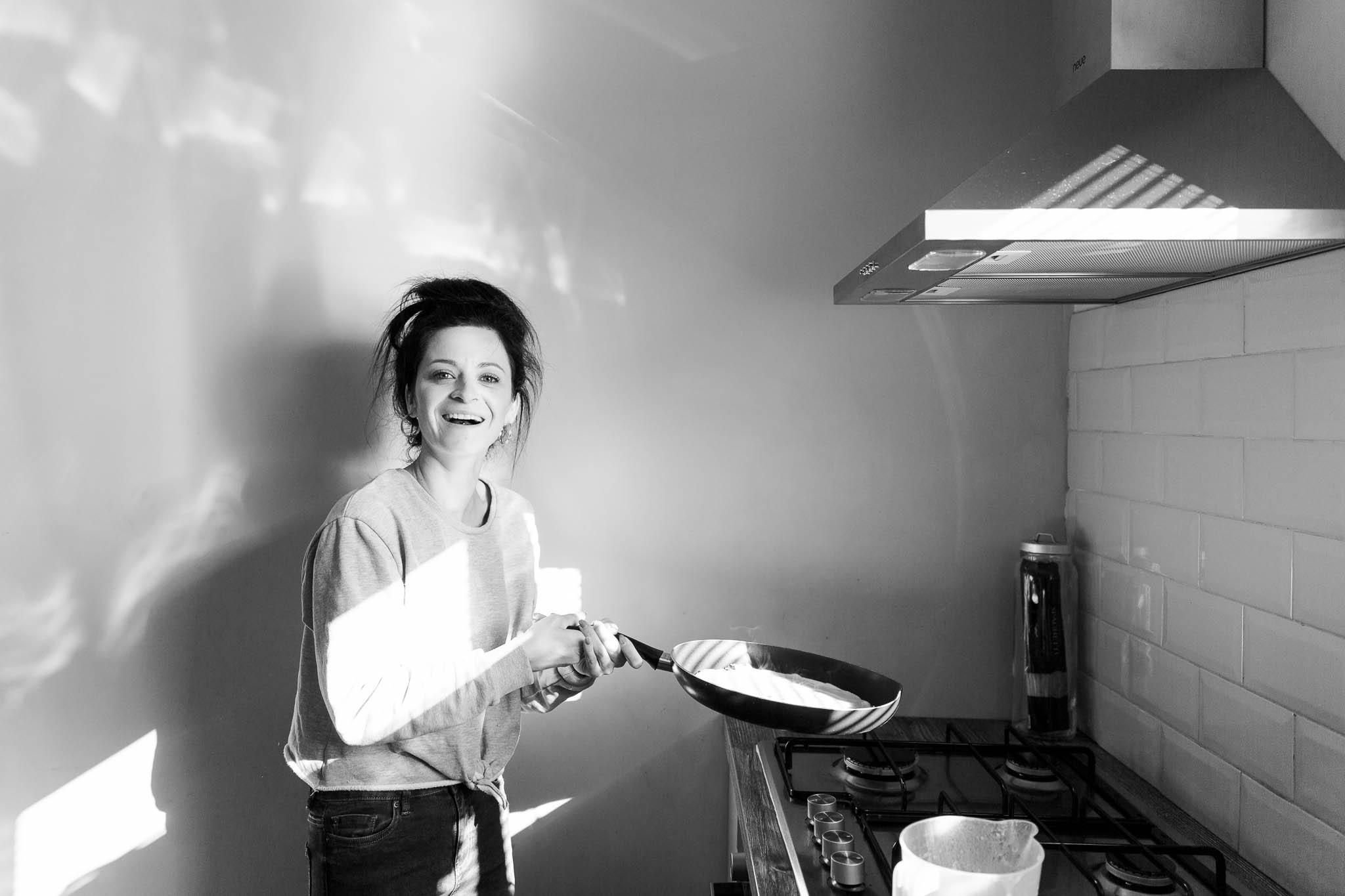 mum flipping pancakes at home