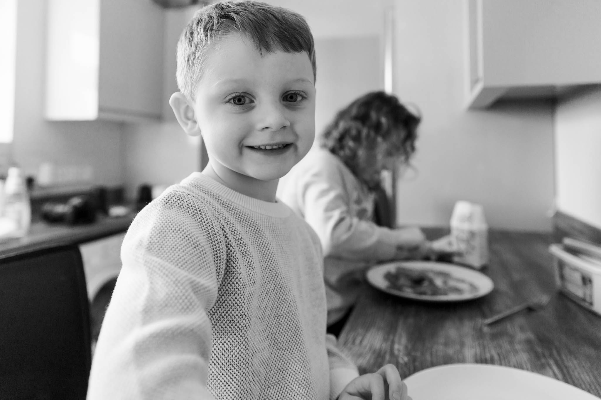little boy smiling and waiting for pancake