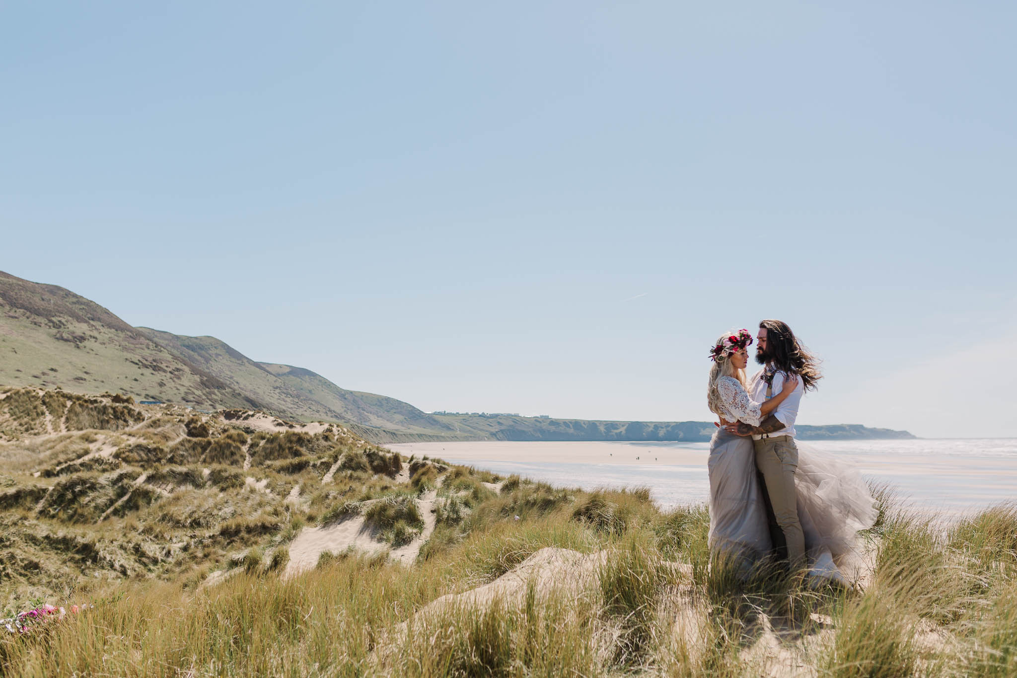 bride and groom on sand dunes