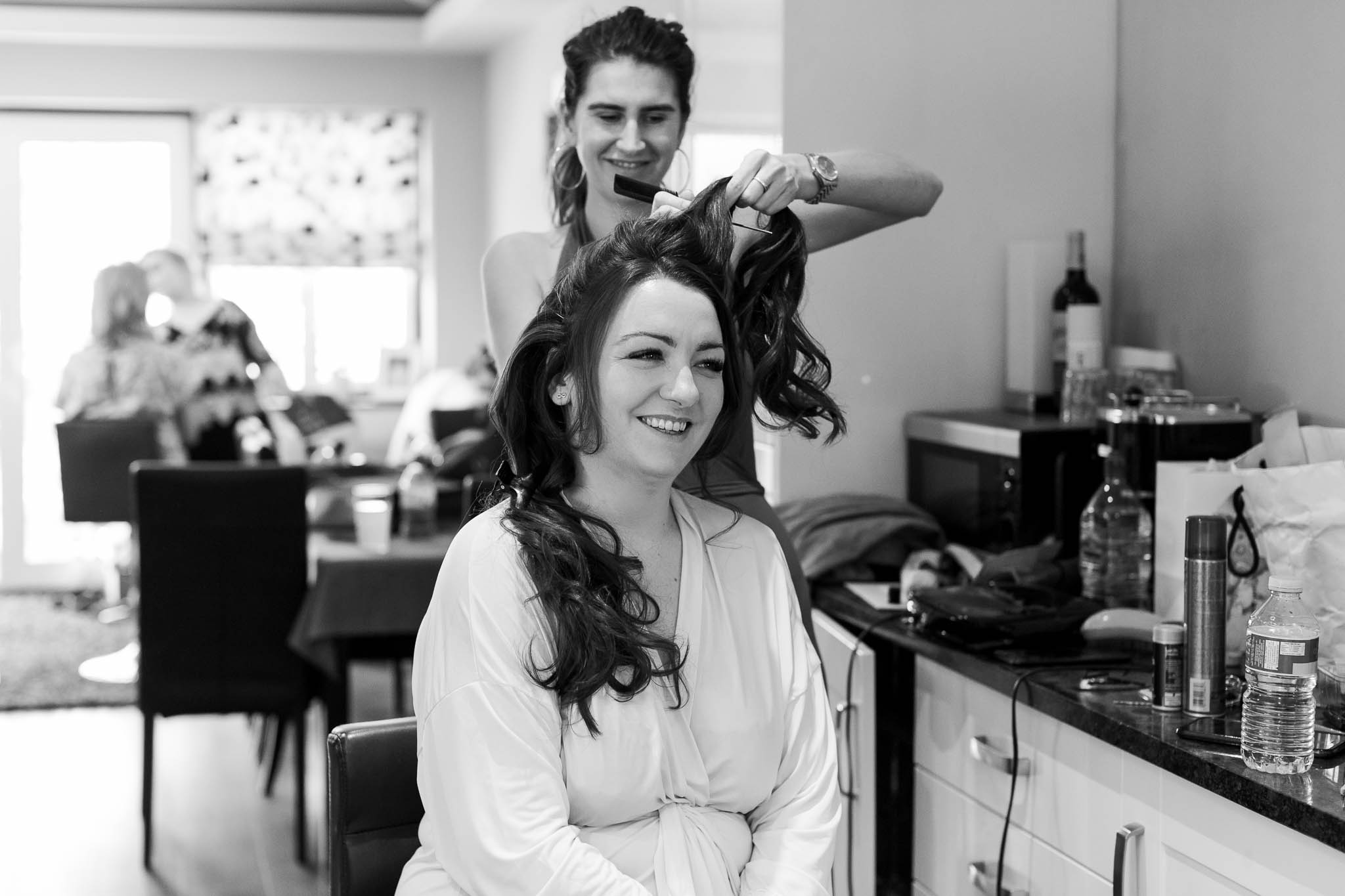 bride laughing during bridal preparations
