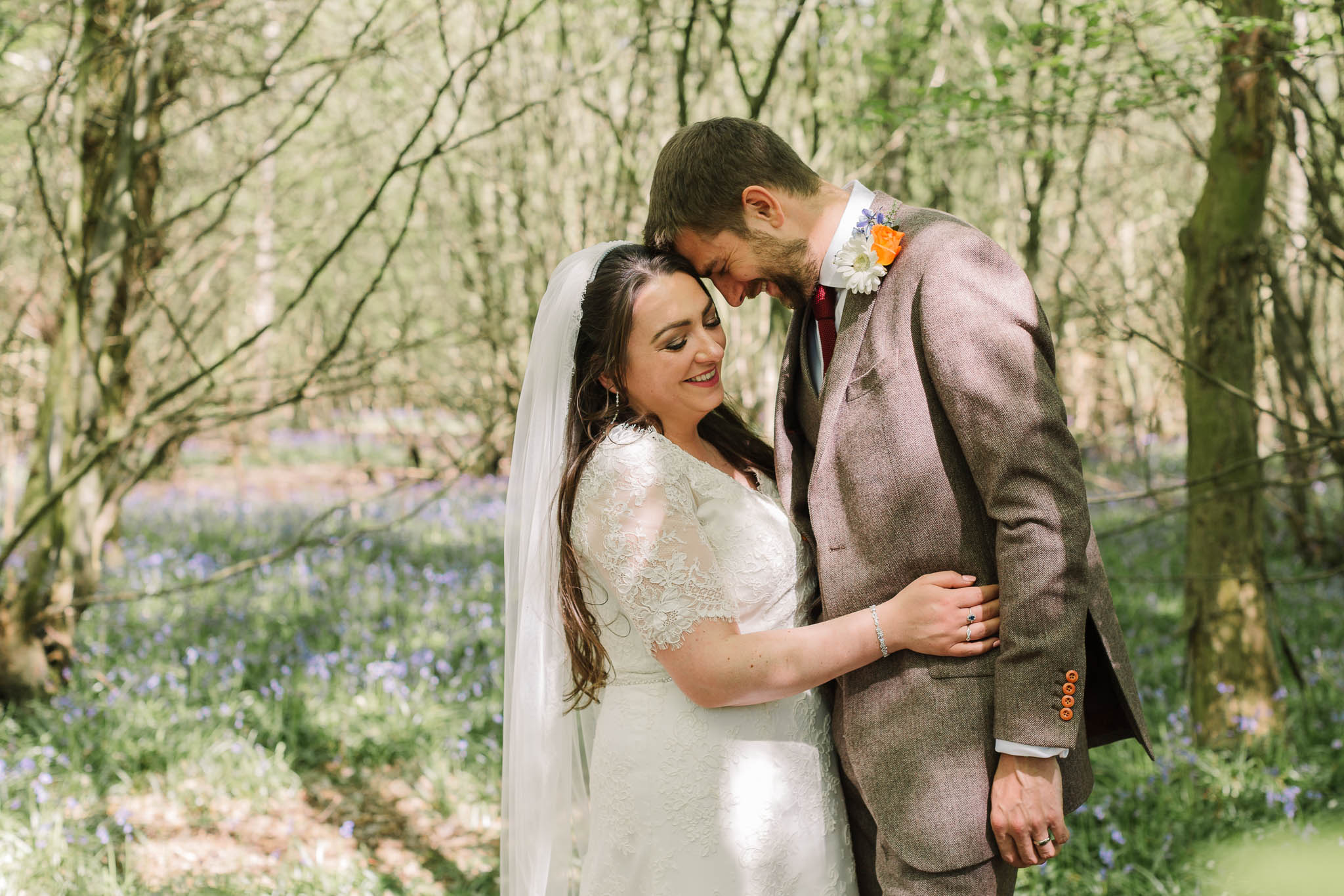 bride and groom in bluebells