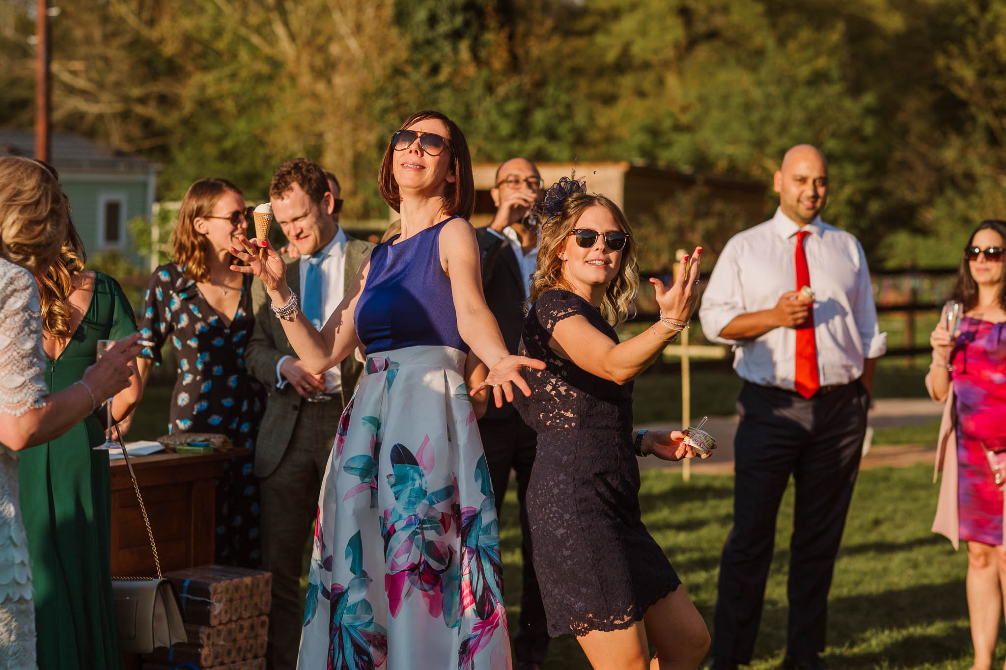 wedding guests dancing in the sun