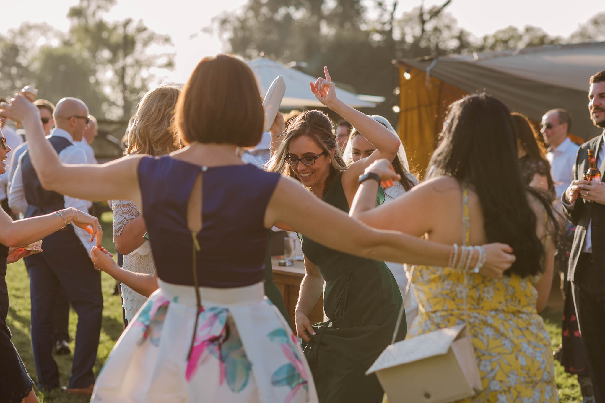 wedding guests dancing at festival style wedding