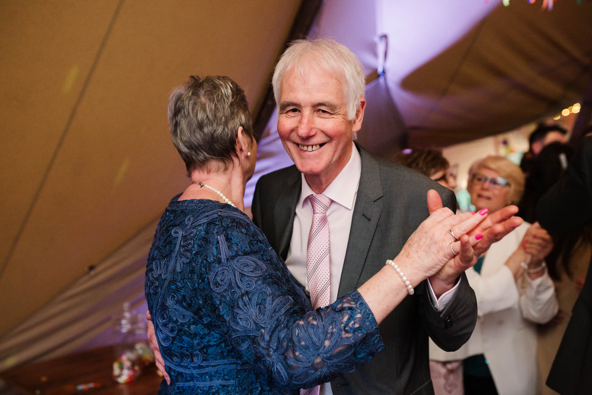 older couple dancing at wedding