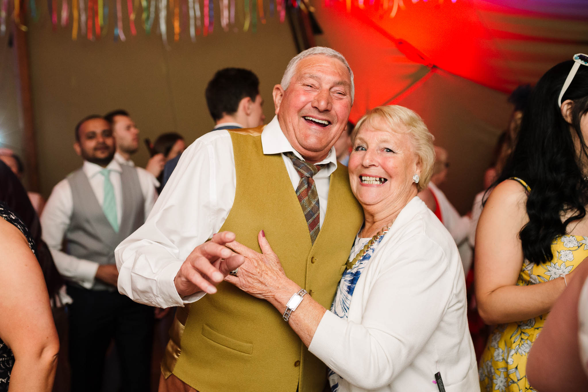older couple smiling and dancing