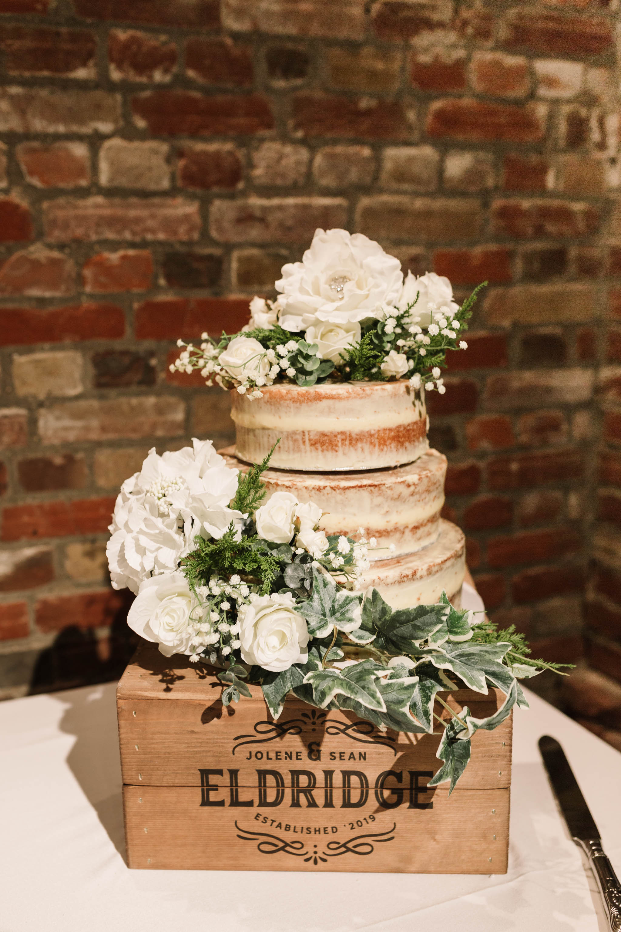 rustic wedding cake with white flowers