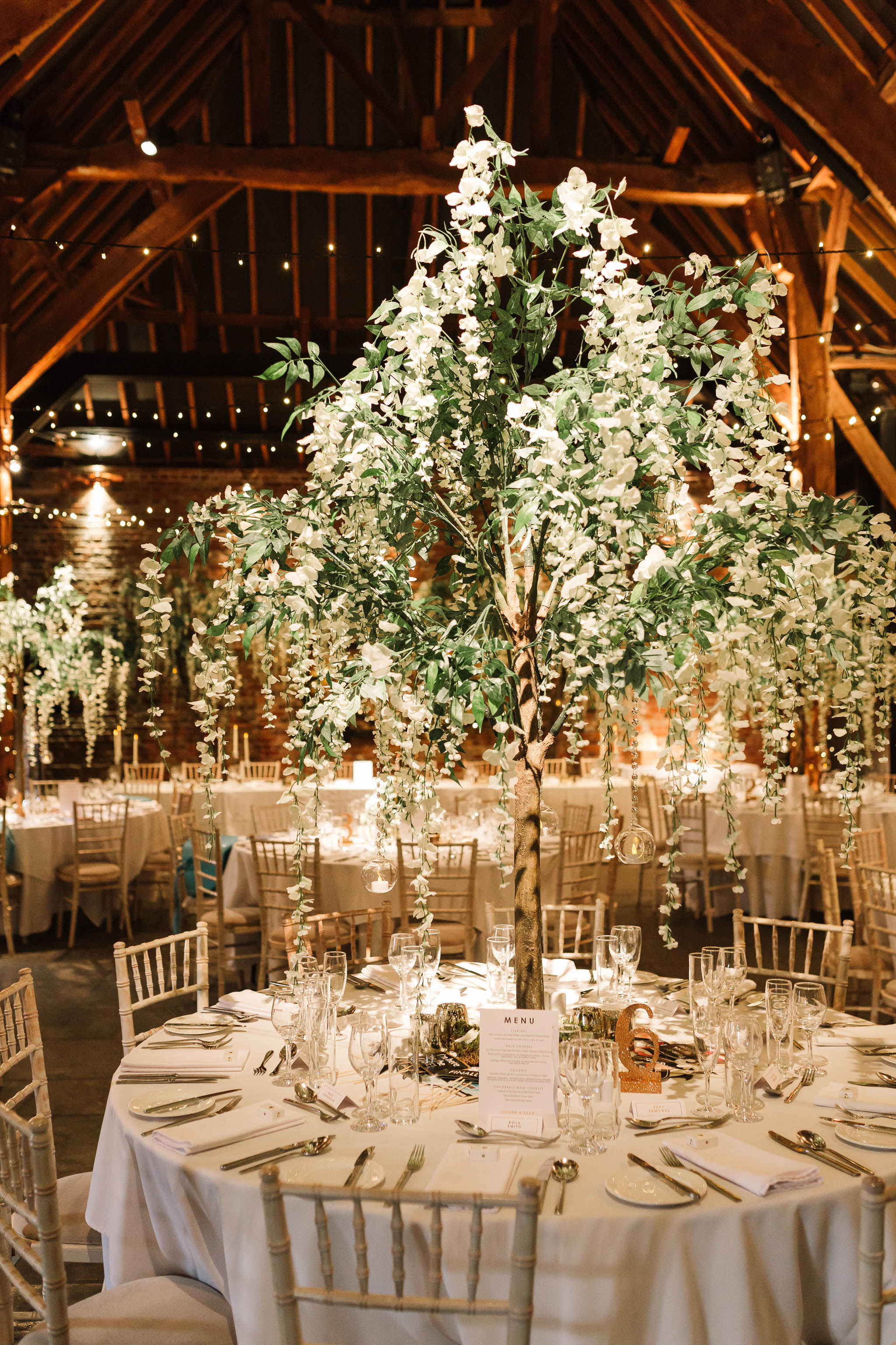blossom trees on tables for spring barn wedding