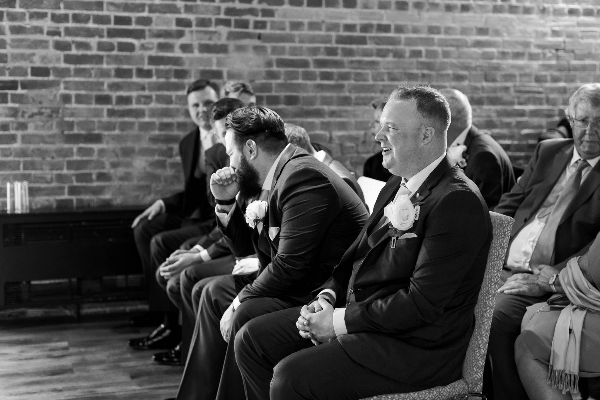 groom and best man laughing before ceremony