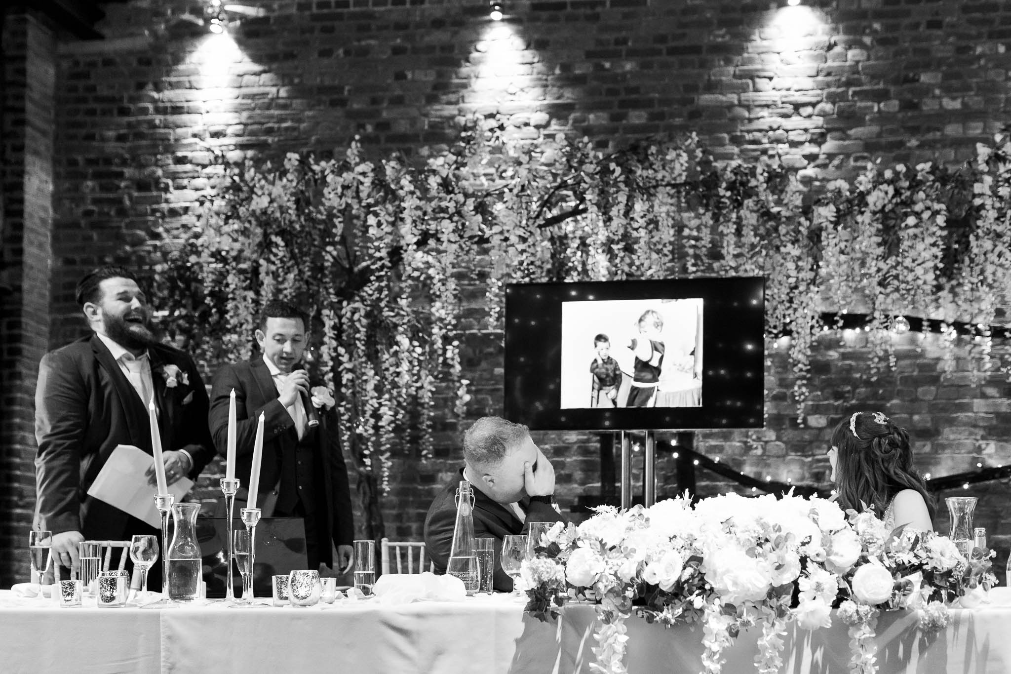 groom covering his face during best men speech