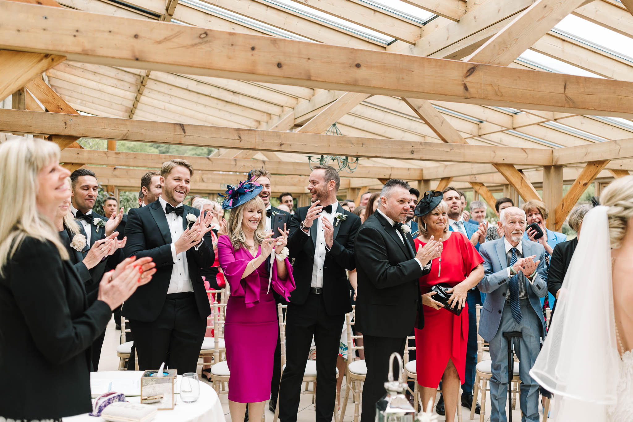 wedding guests clapping during ceremony
