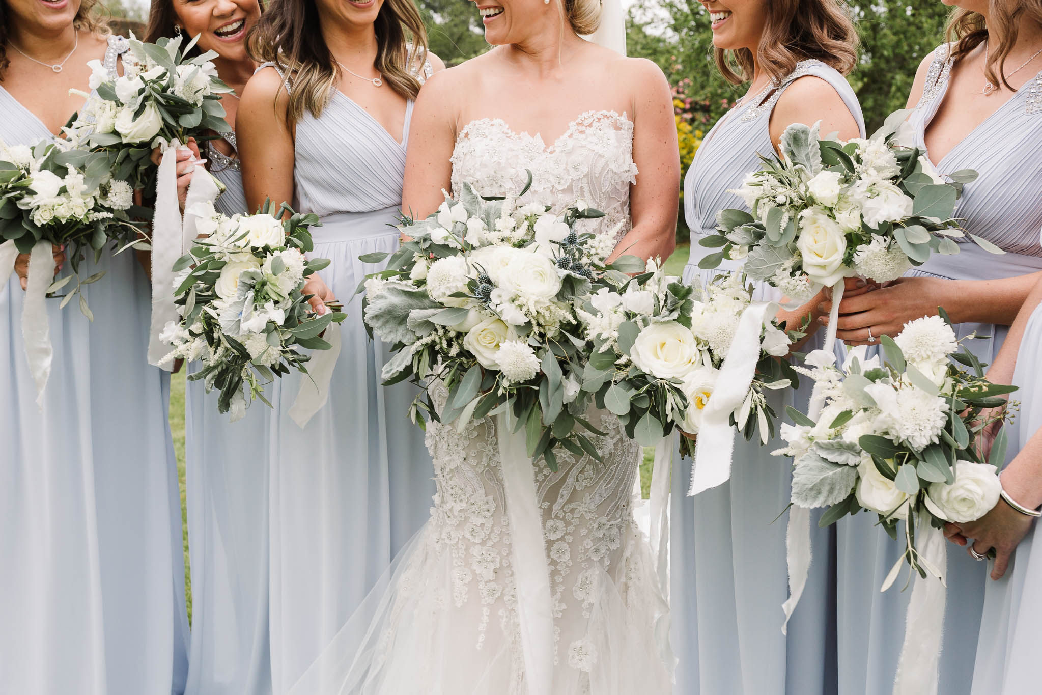 white wedding flowers with soft blue bridesmaid dresses