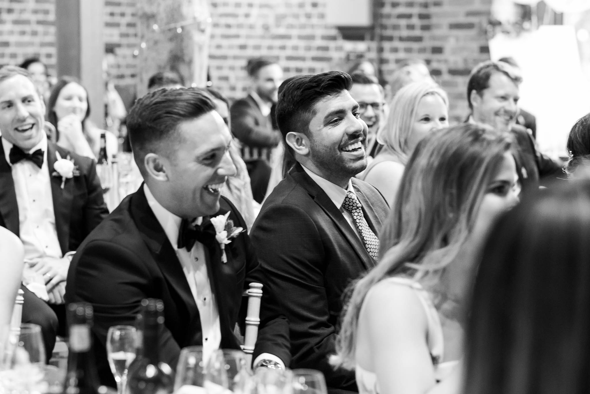 groomsmen laughing at speeches