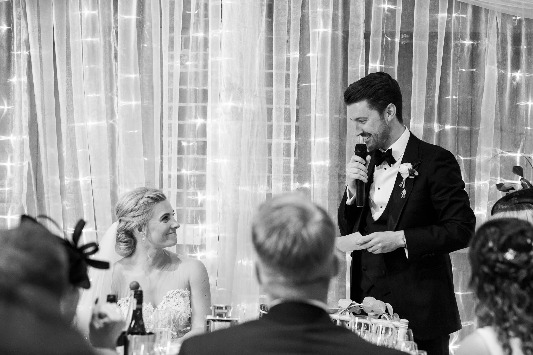 groom giving speech to new wife