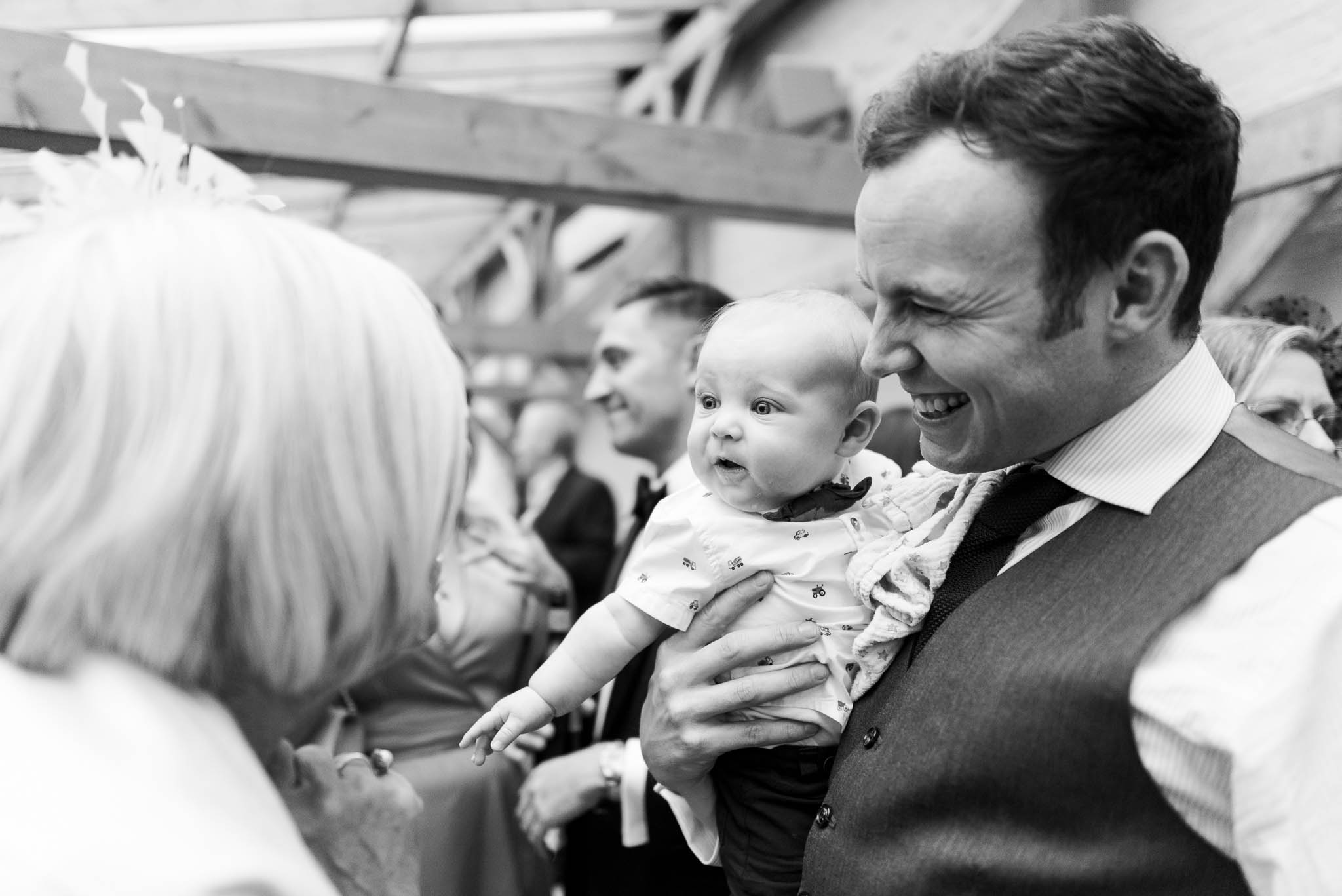baby with dad at wedding