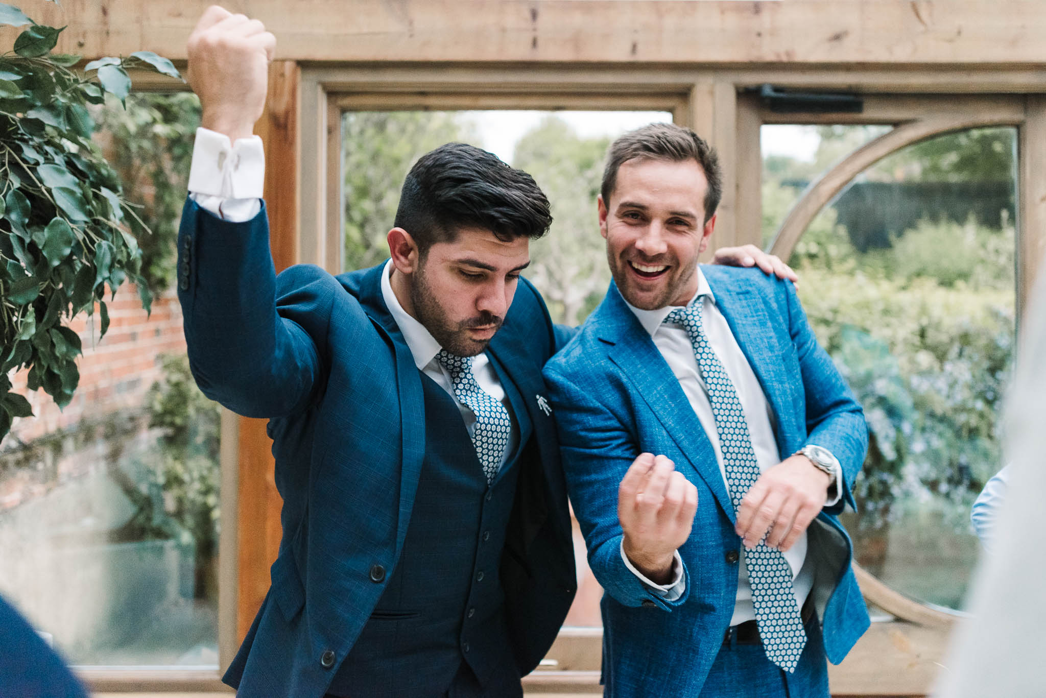 men having fun at wedding