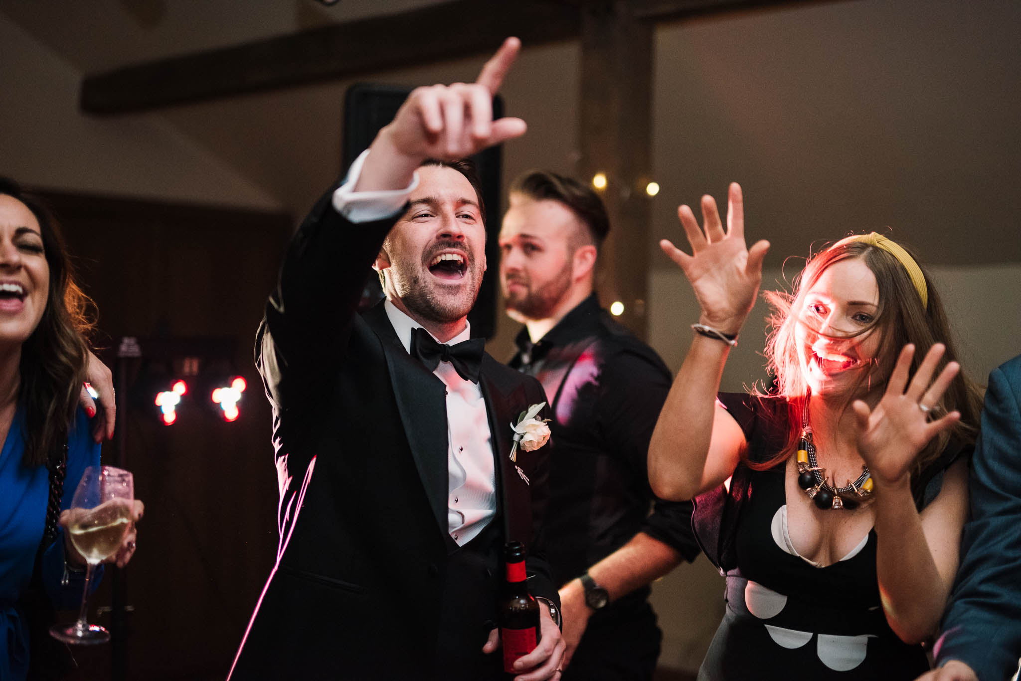 groom dancing with guests at gaynes park