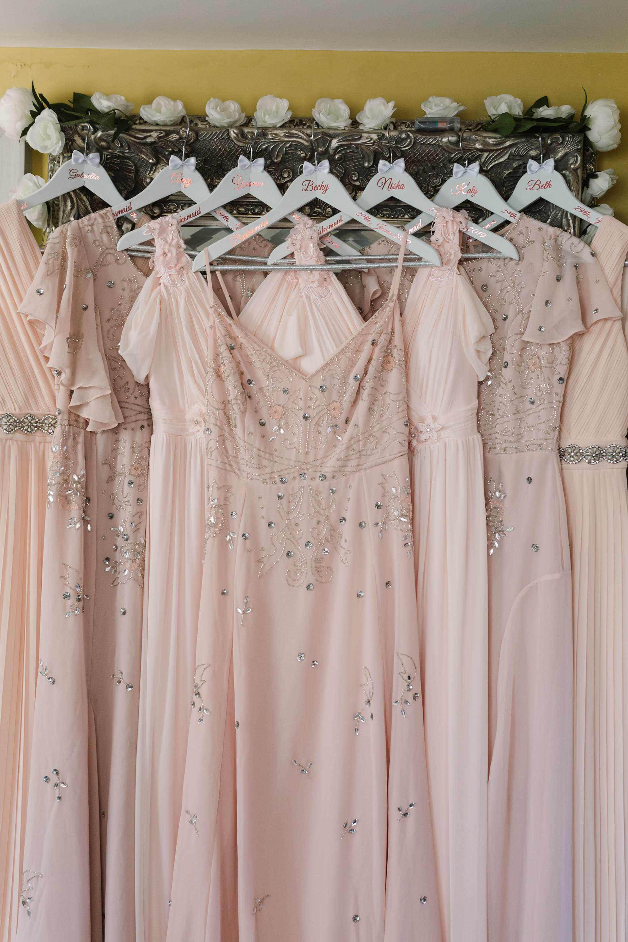 array of pink vintage bridesmaids dresses