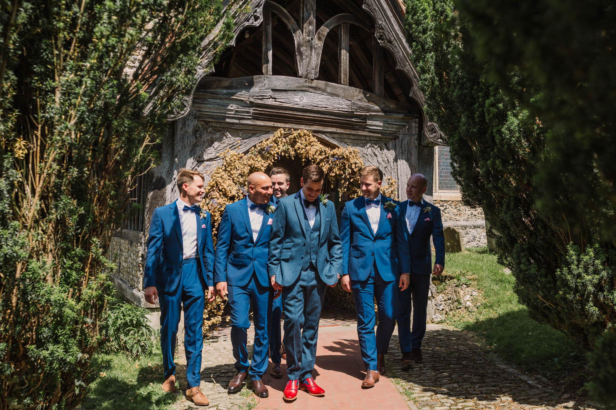 groom and groomsmen outside church