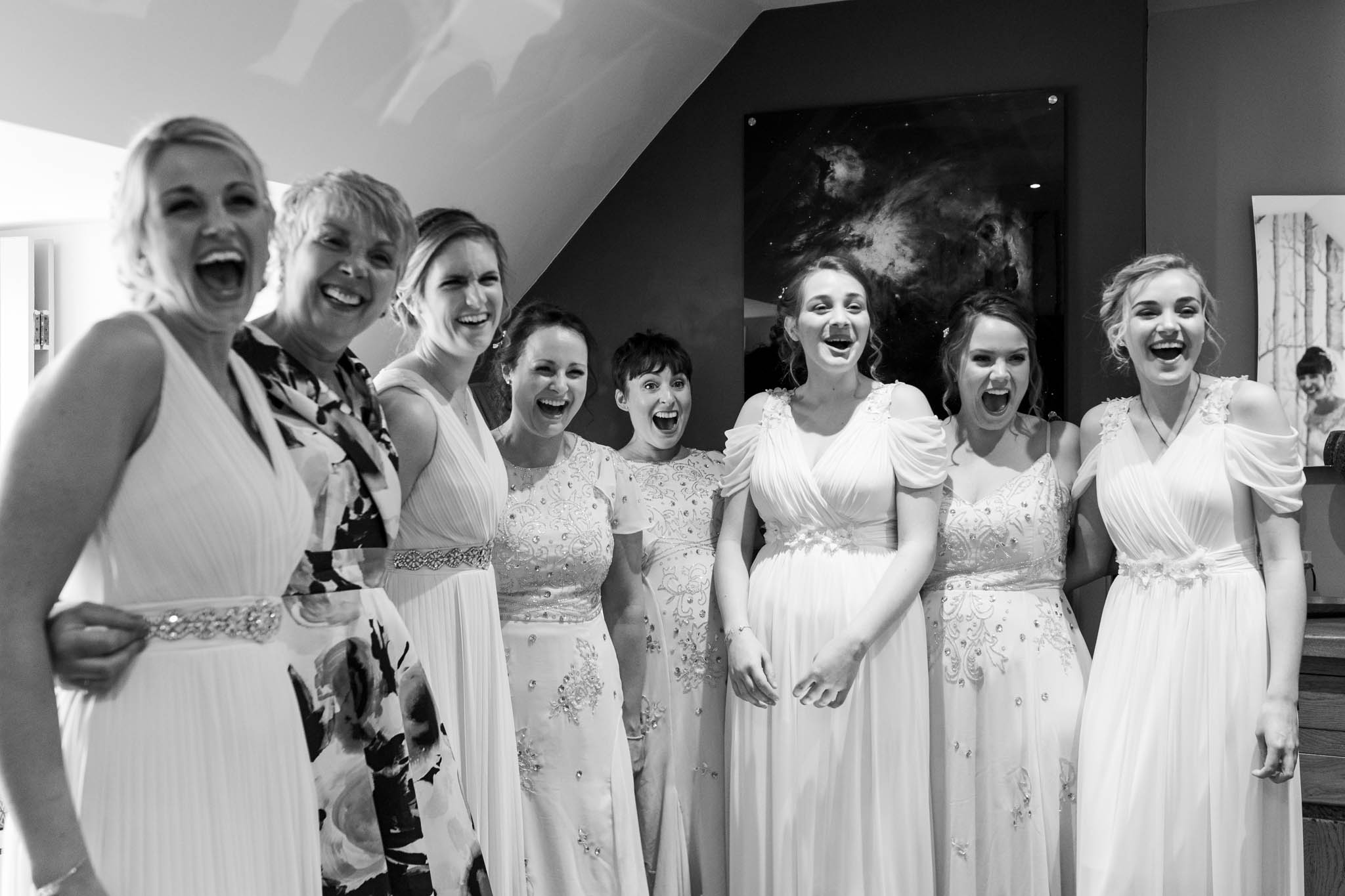 bridesmaids looking shocked and excited when they see the bride
