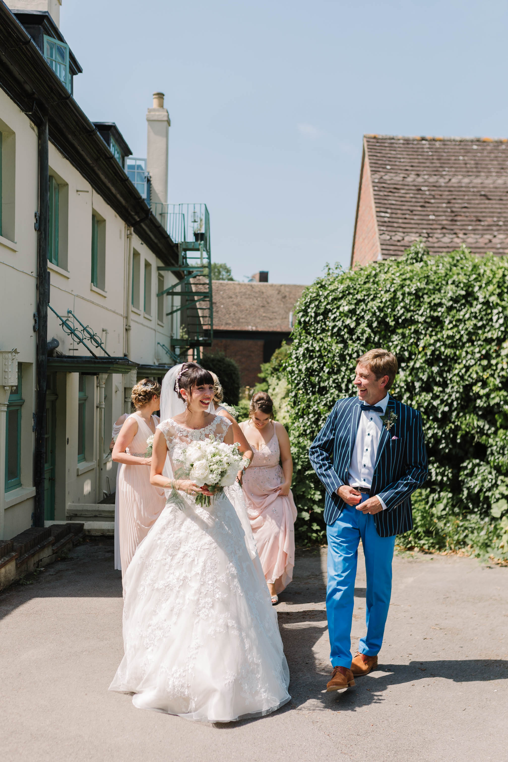 bride and her dad walking to church