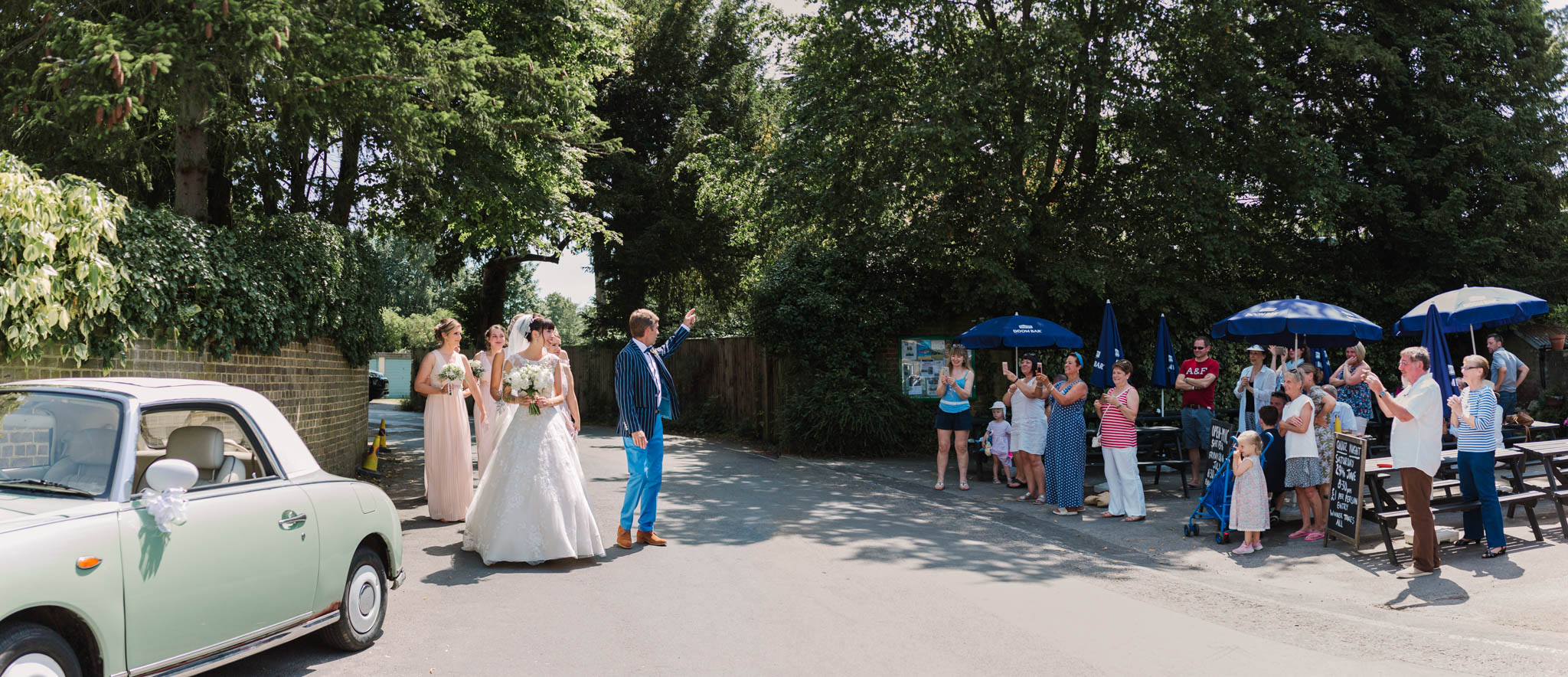 bride attracting crowds as she walks to the church