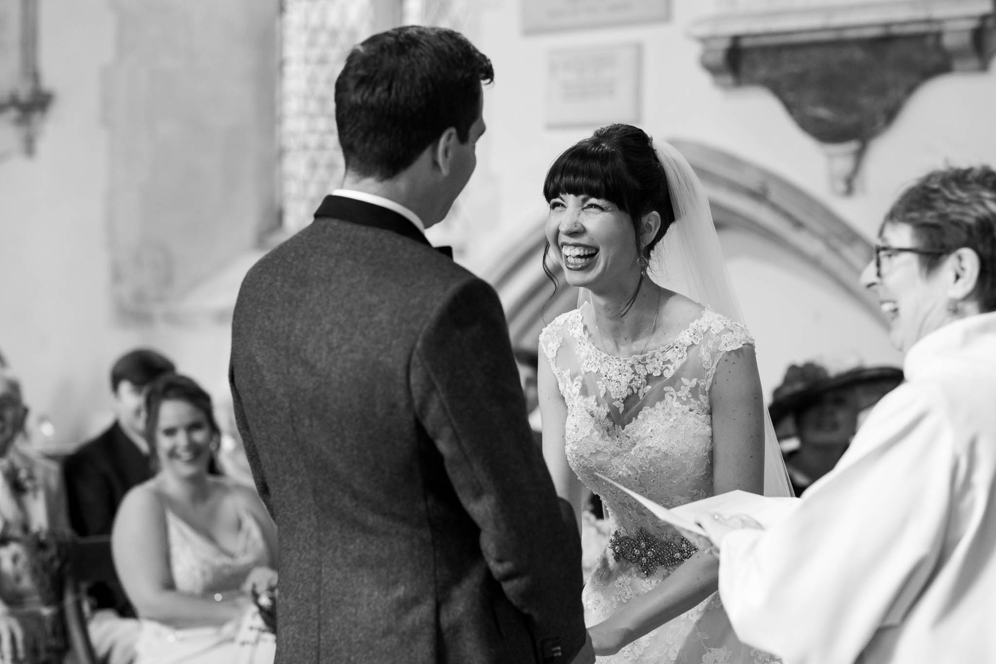 bride laughing during church service