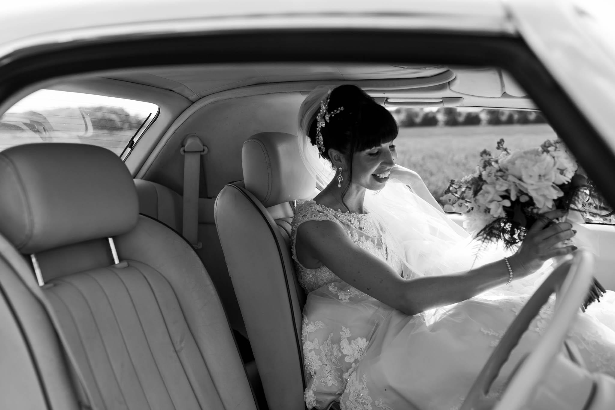 bride sitting inside vintage car