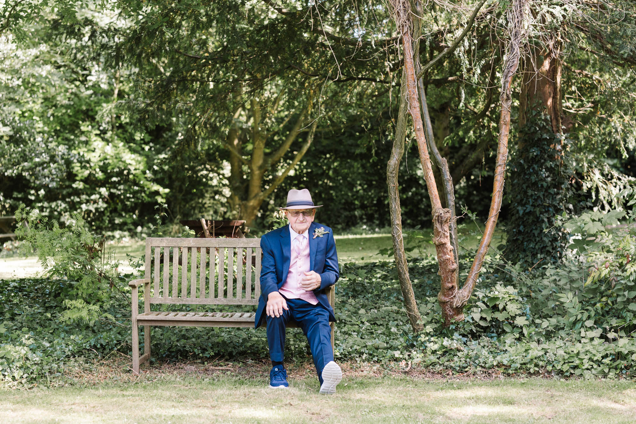 granddad sitting on bench in suit