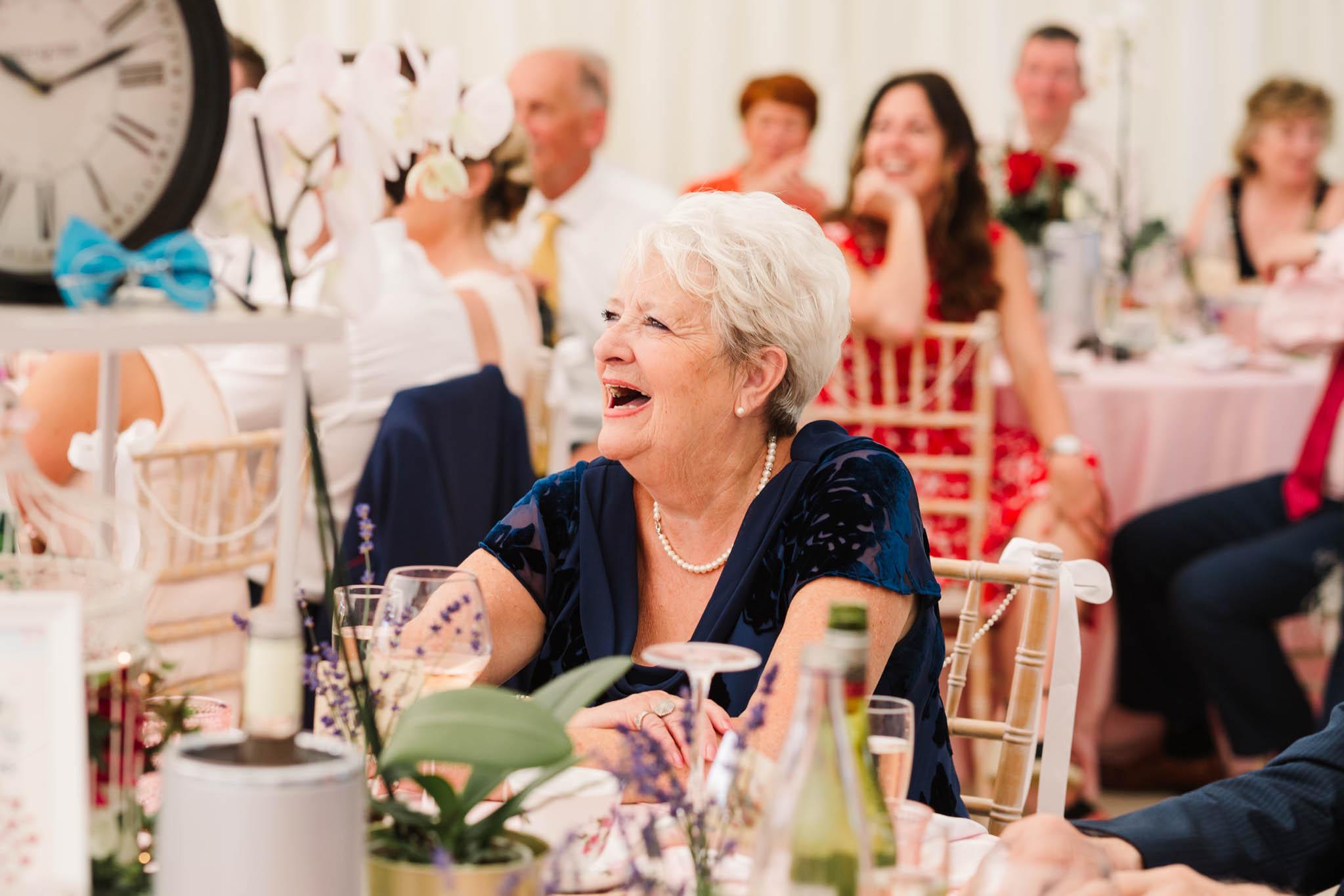 nan laughing at table