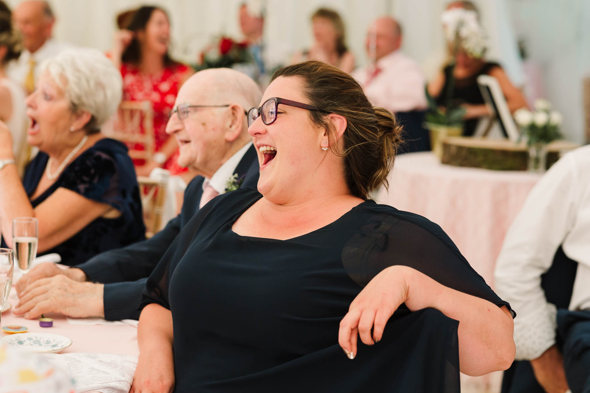 guest laughing at her seat