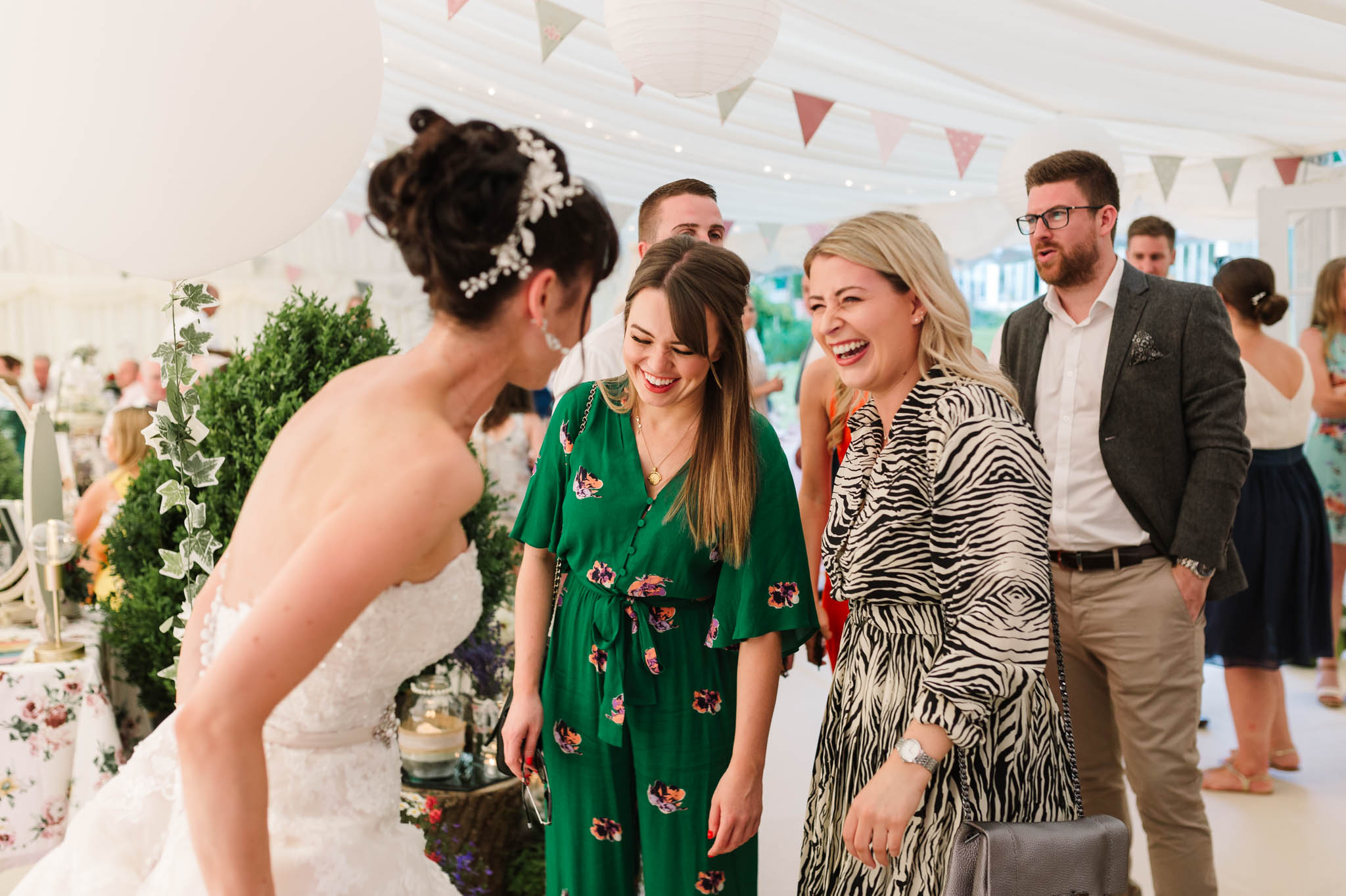guests laughing and greeting bride