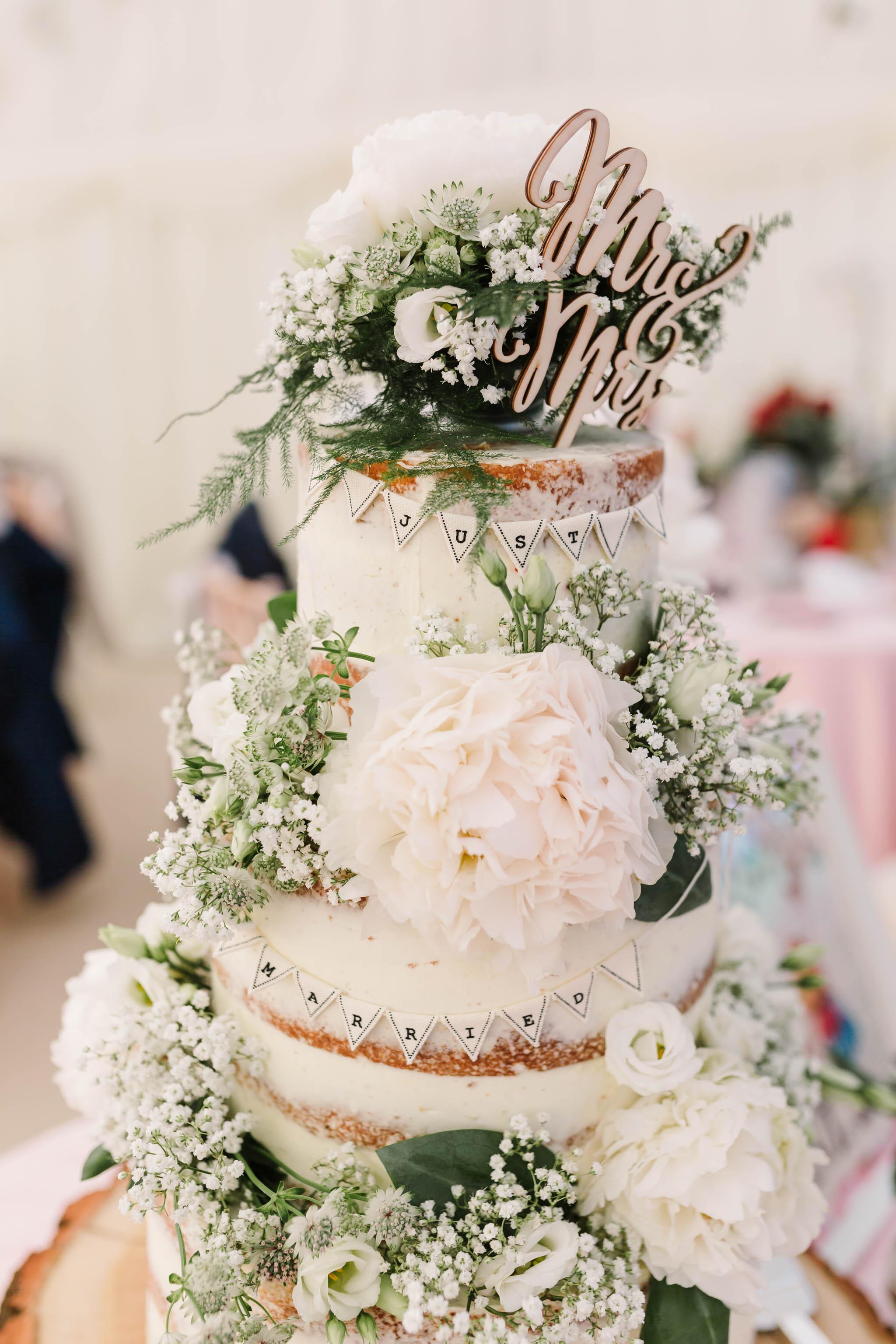 semi naked cake alice in wonderland wedding