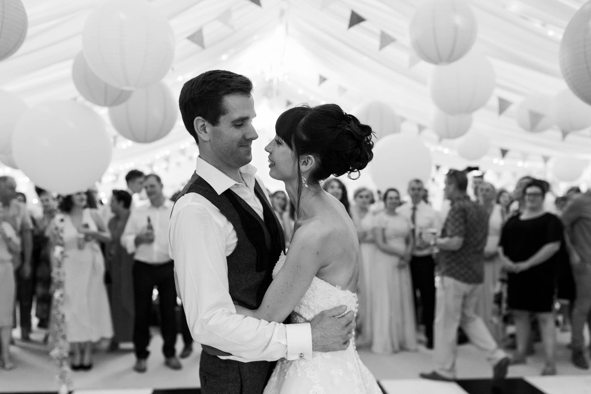 bride and groom dancing at alice in wonderland wedding