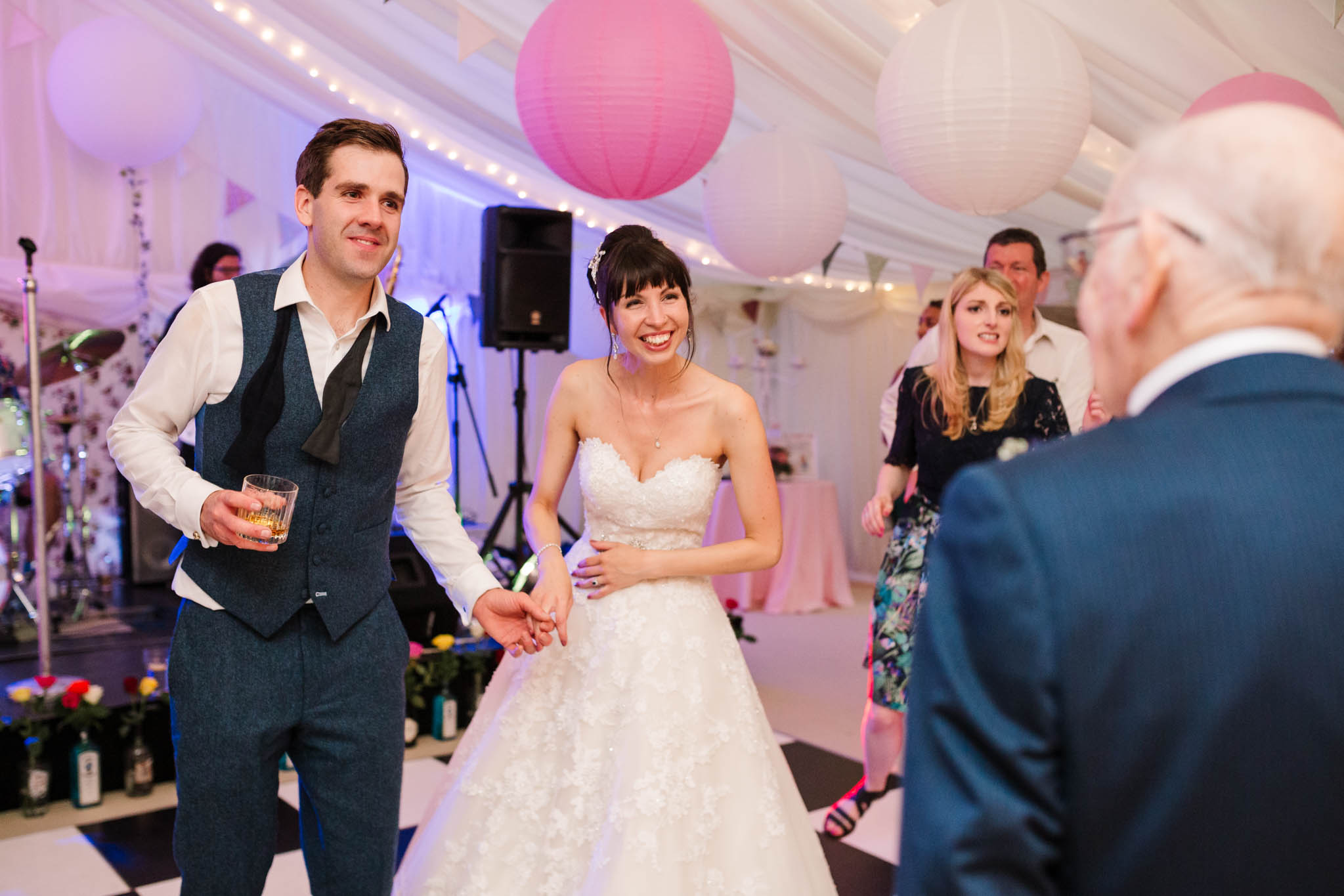bride and groom laughing on dance floor