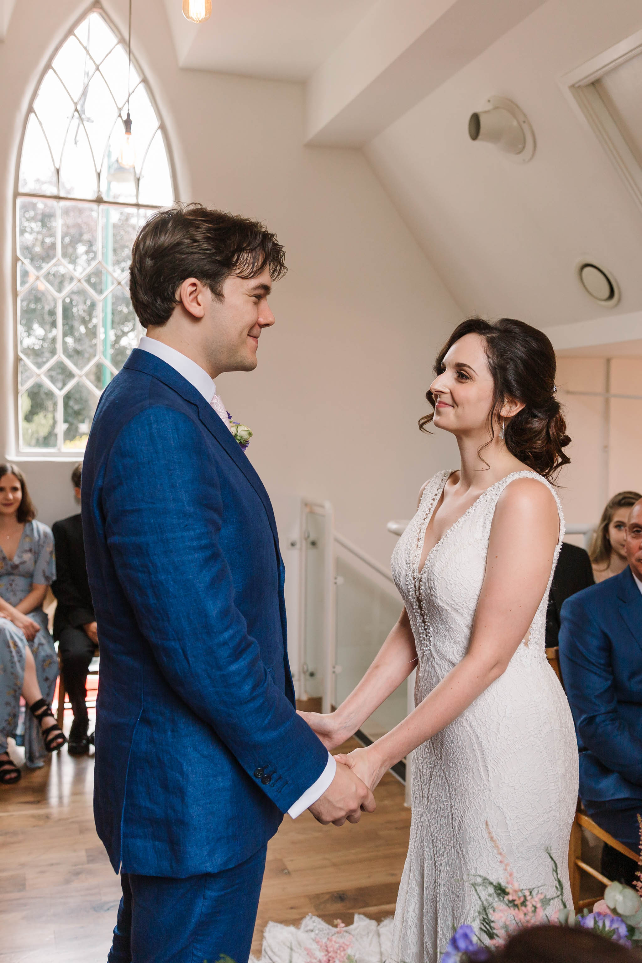 bride and groom excited during wedding ceremony - old parish rooms wedding