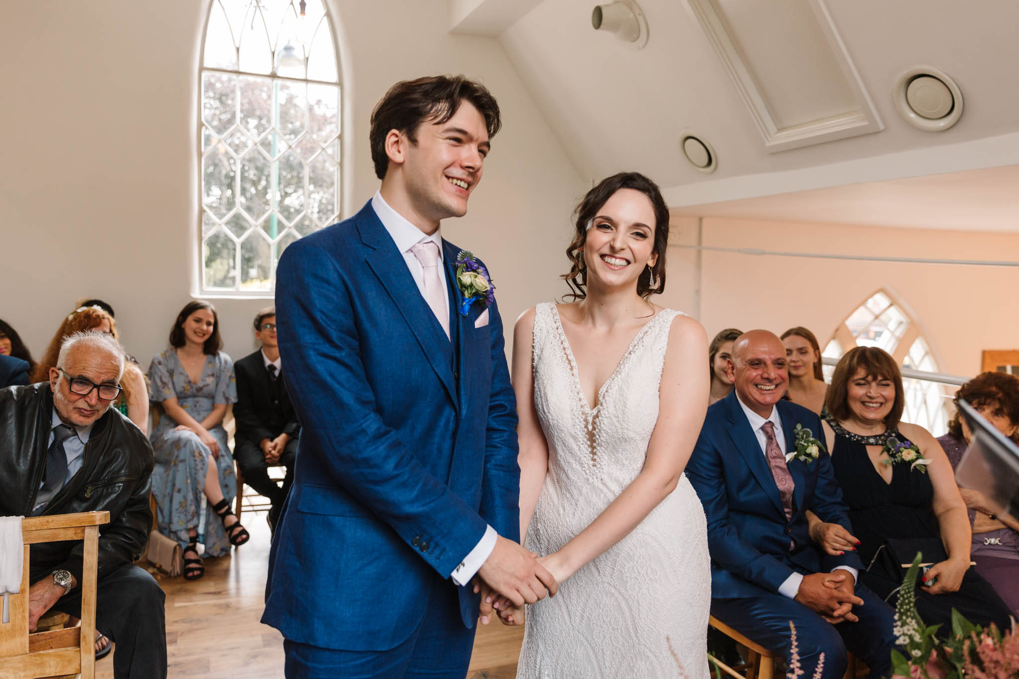 bride and groom laughing during ceremony at old parish rooms