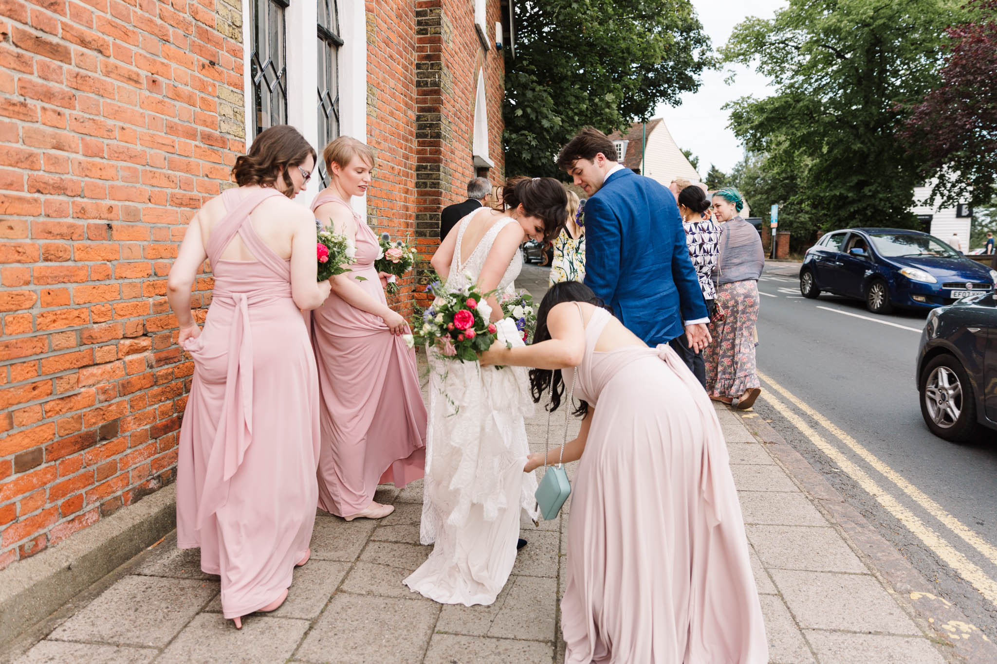 bridal party walking down street