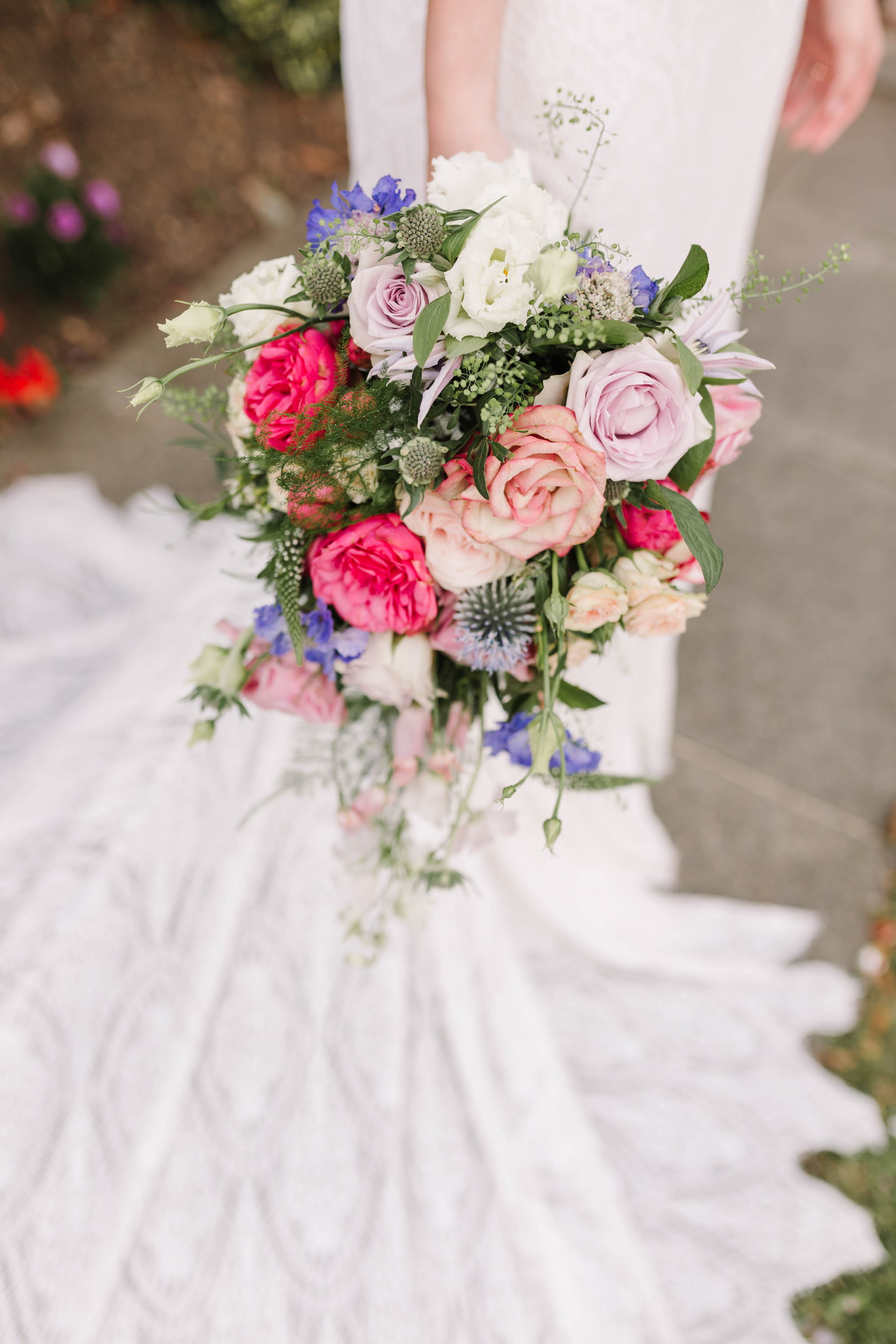 colourful wild wedding bouquet with brides train