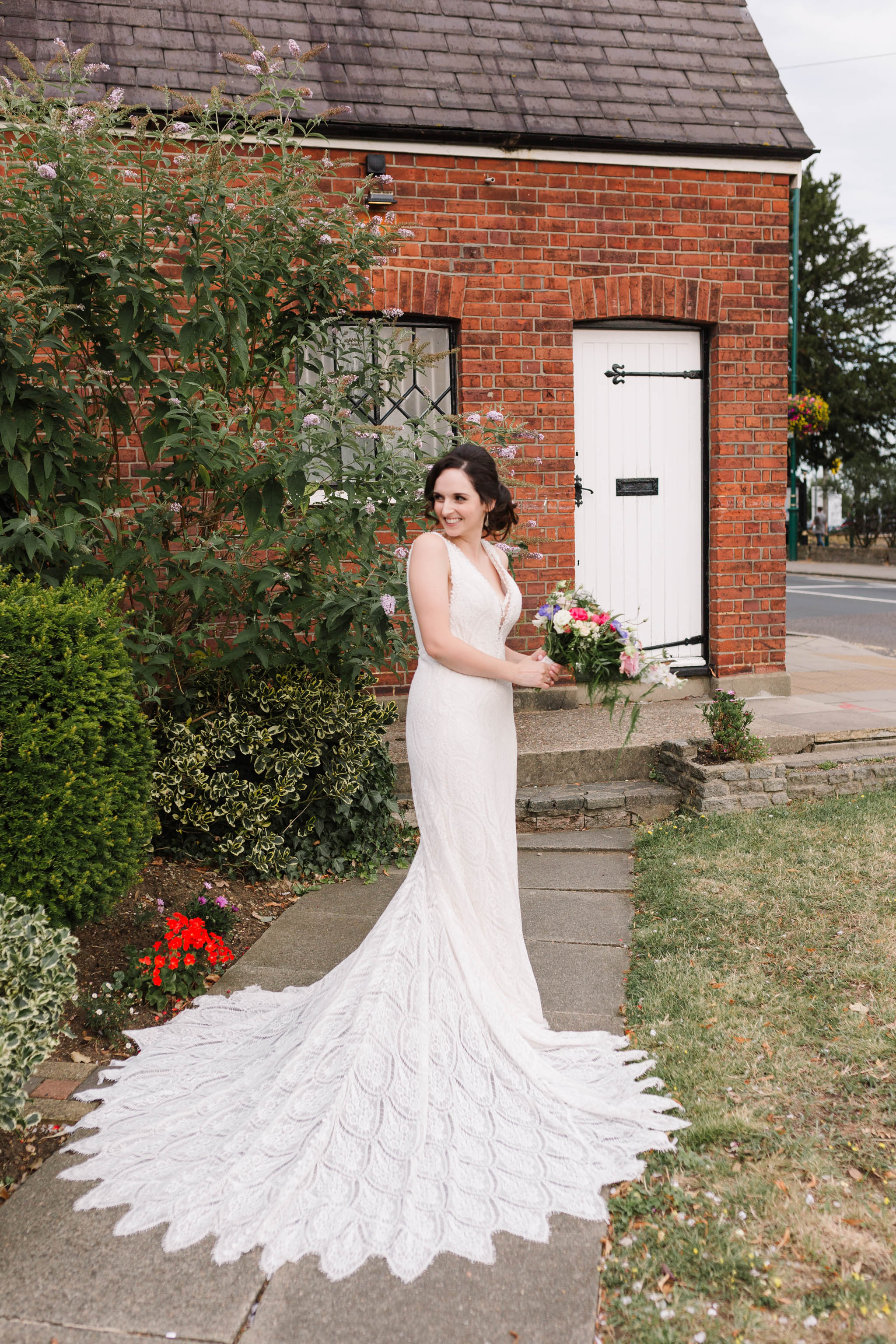 bride with beautiful train on dress- old parish rooms wedding