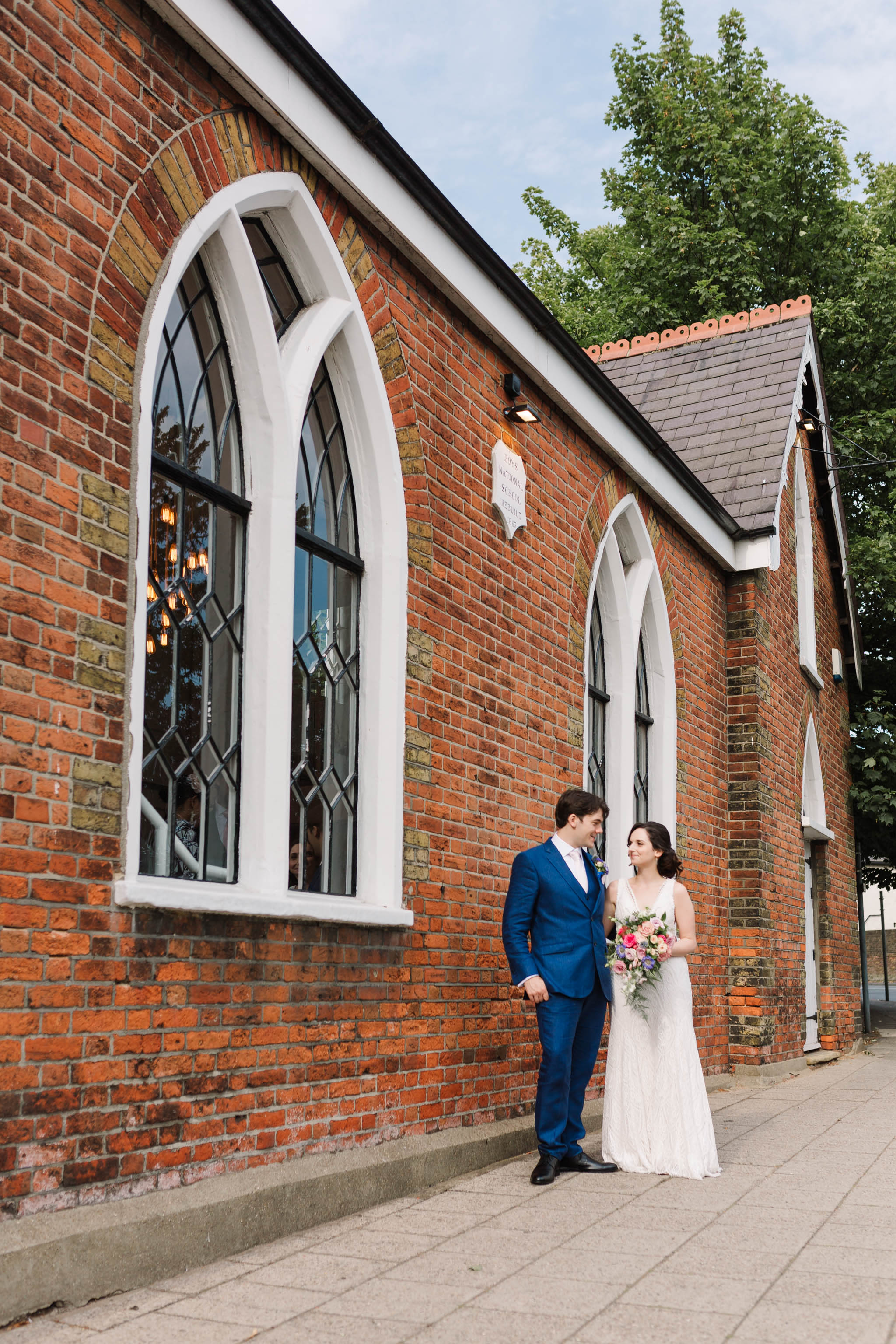 bride and groom outside old parish rooms wedding venue