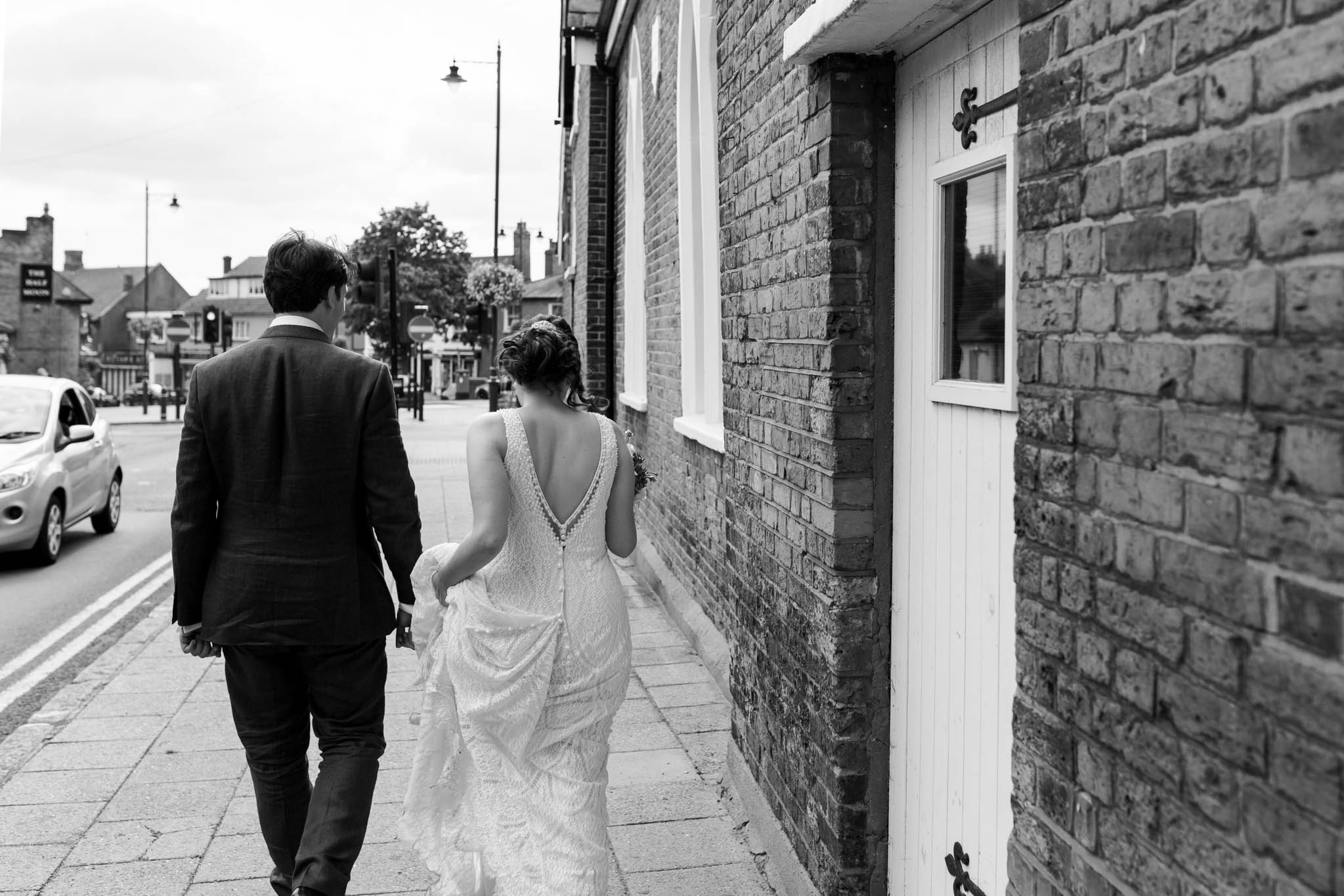 bride and groom walking outside venue- old parish rooms