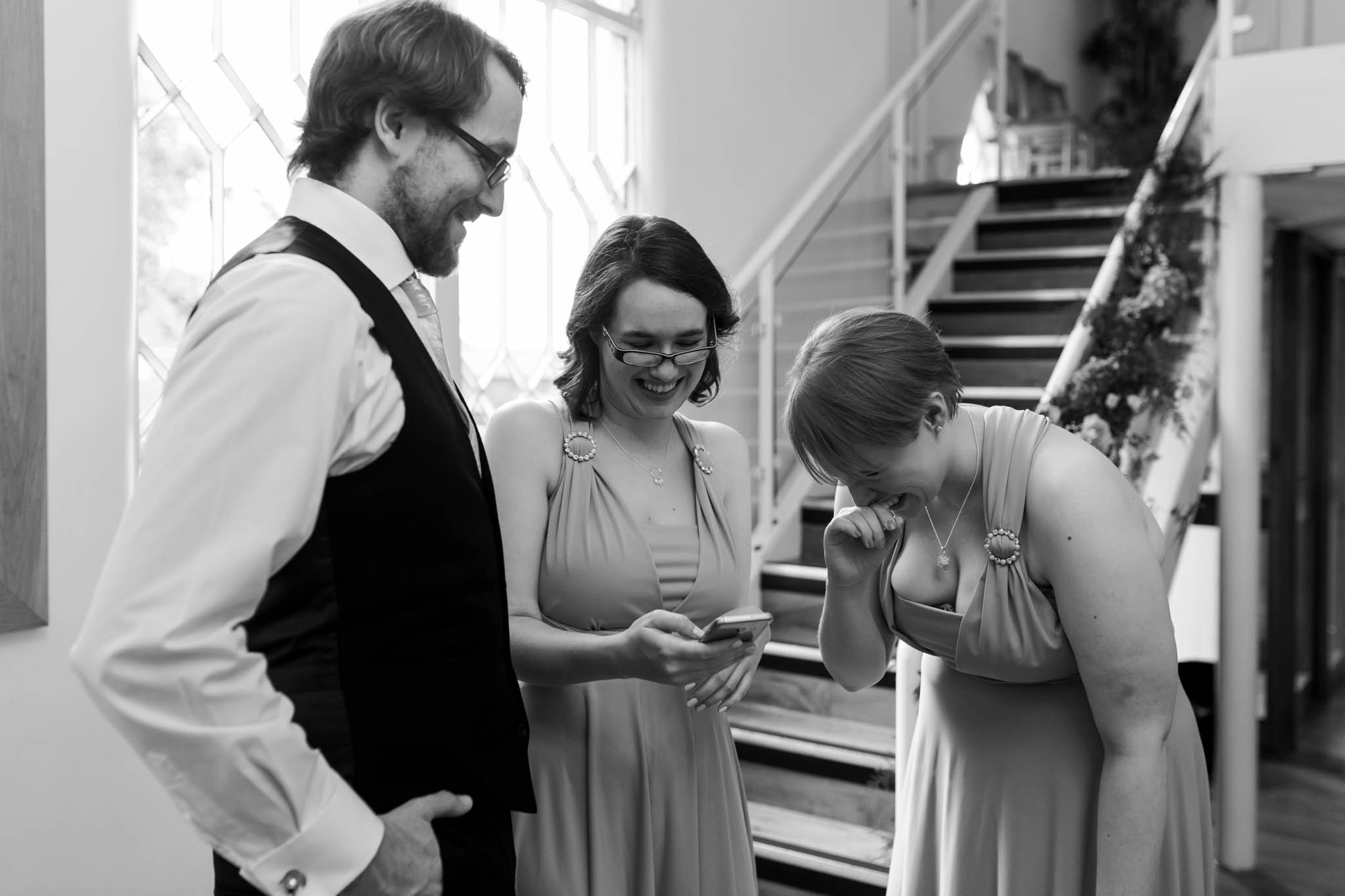 bridesmaids and best man laughing