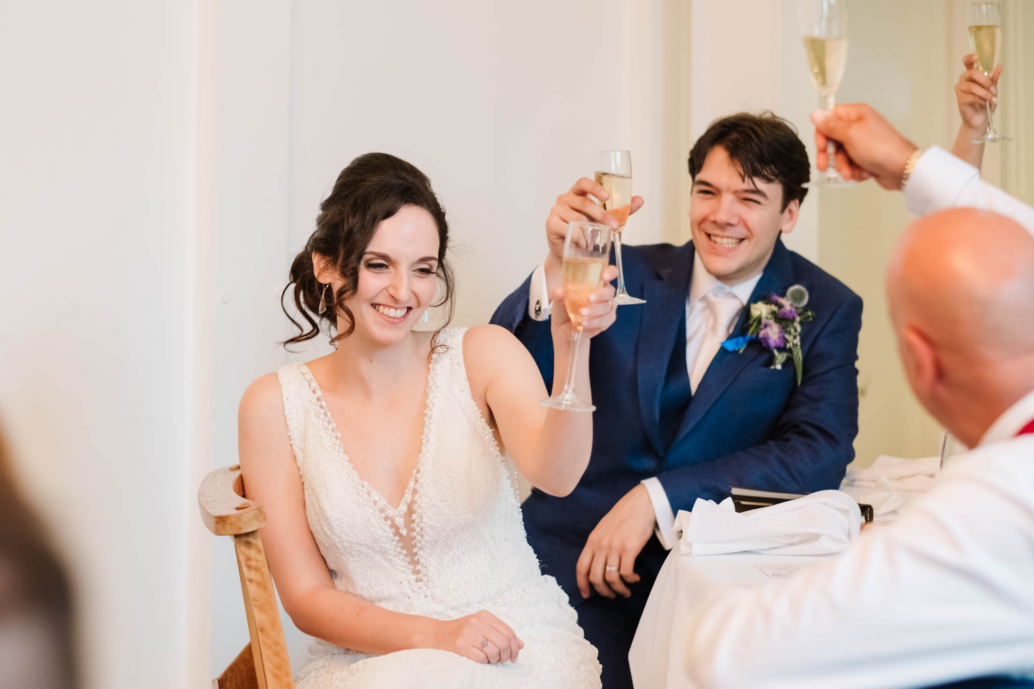bride and groom toasting during speeches